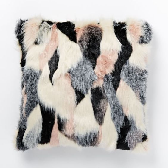 PINK THROWS - Sometimes, all it takes is a little added dose of pink to make an interior! Mixed with gray, black, and white--and you've got a sophisticated color scheme for any room!