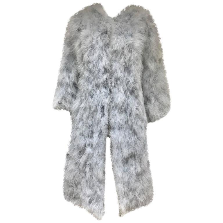 Vicky Valere light blue feather coat.jpg