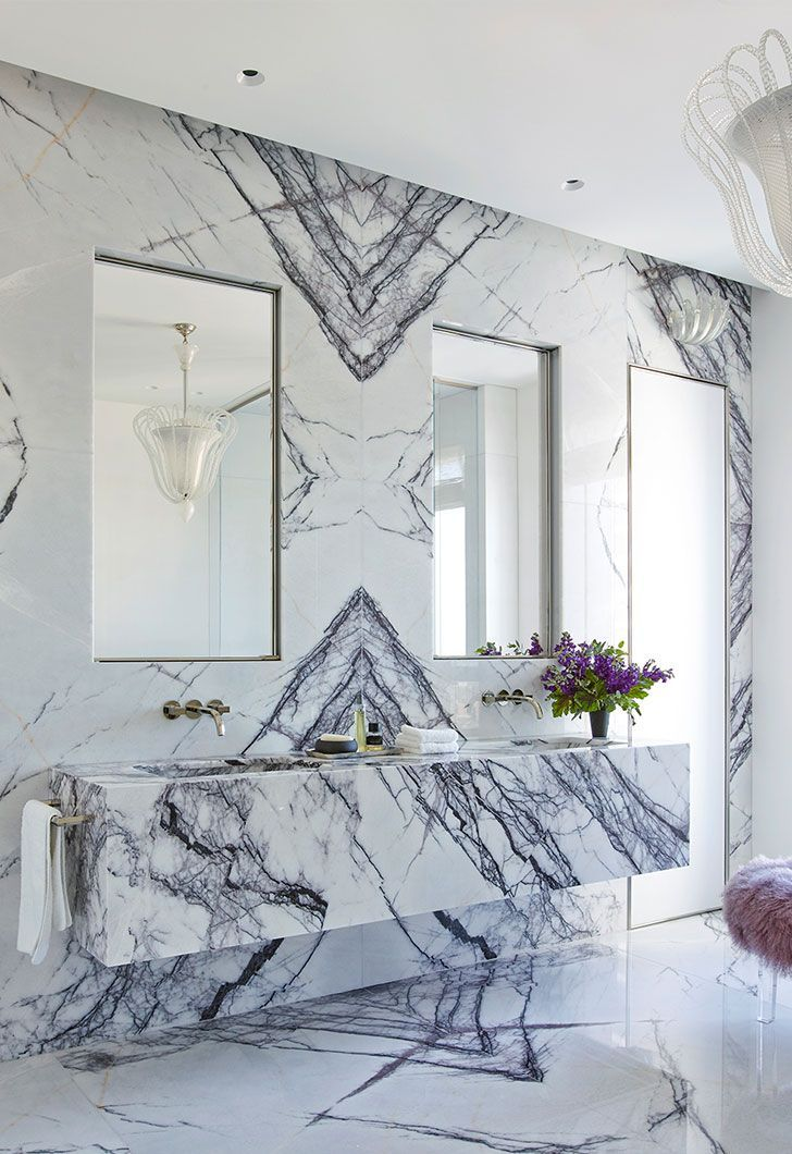 Luxe Interiors - Kara Mann knows how to elevate a space—especially with this custom Italian Lilac Marble bathroom!
