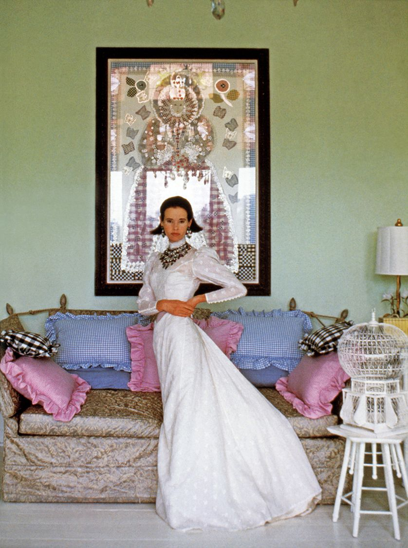 c.1969 - Vanderbilt posing in front of one of her collages, Gingham Queen Elizabeth, on the balcony of her Southampton home, photographed by Francesco Scavullo.