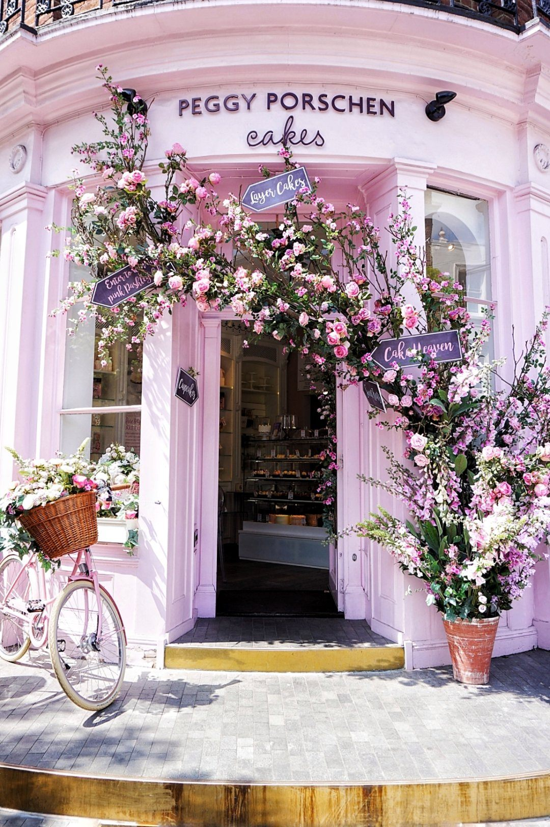 Peggy Porschen Cakes - 116 Ebury St, Belgravia w/ multiple locationsThe most photographed facade in London! Pop into one of Peggy's parlours for a sweet treat and snag a take-away box for later! Get there early to beat lines and escape into a dreamlike world of cakes and blossoms!