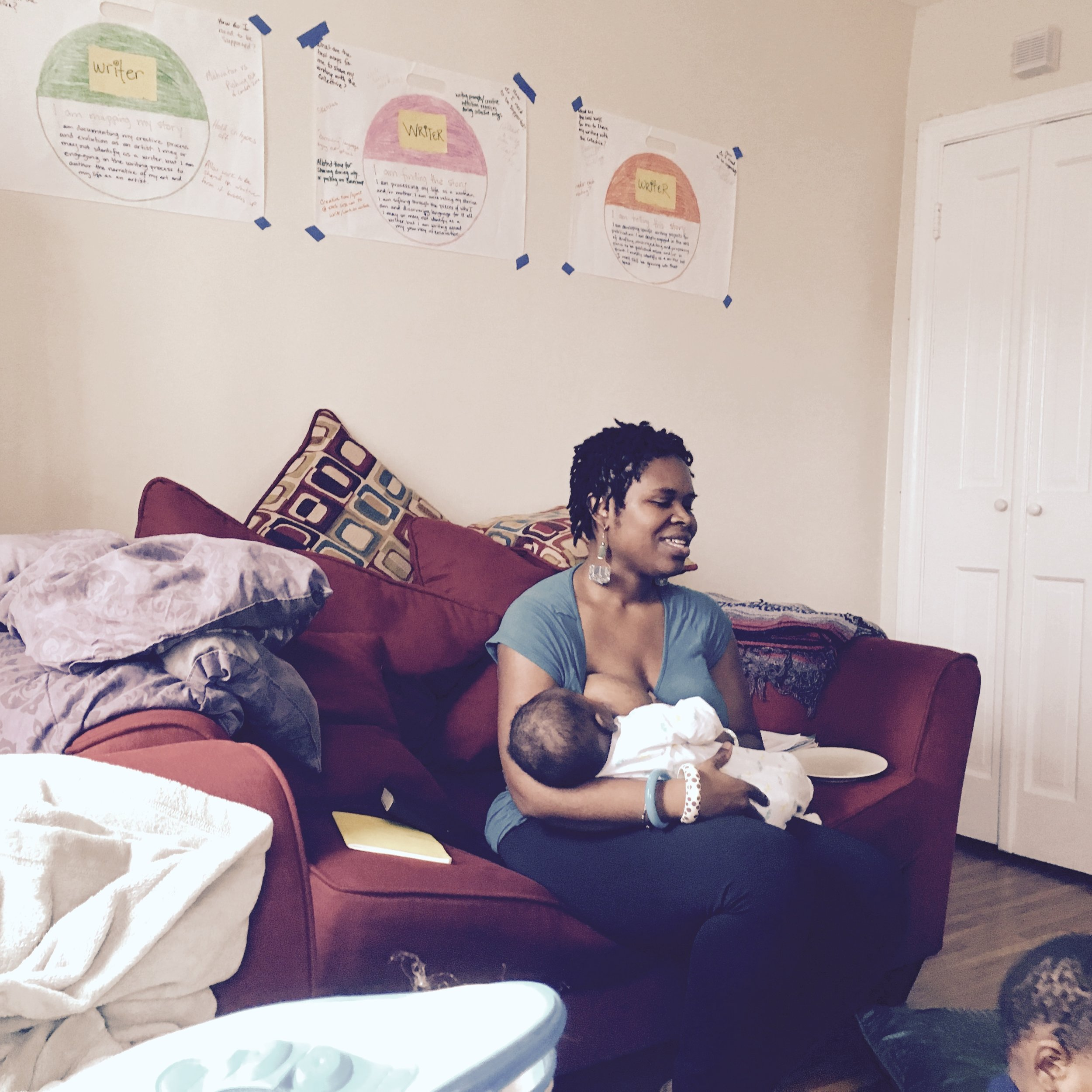 Nursing baby Wonder at a Mothering Gourd Writers Collective gathering, November 2015