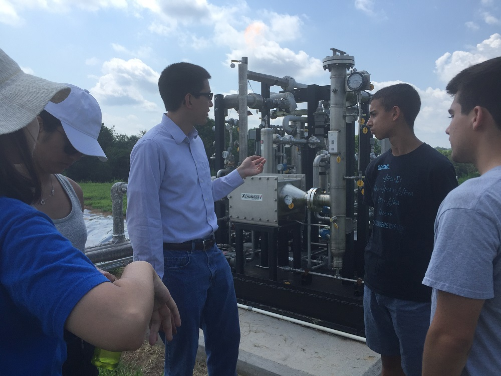 Charles Adair provides an explanation of the project site to a group of Duke students.