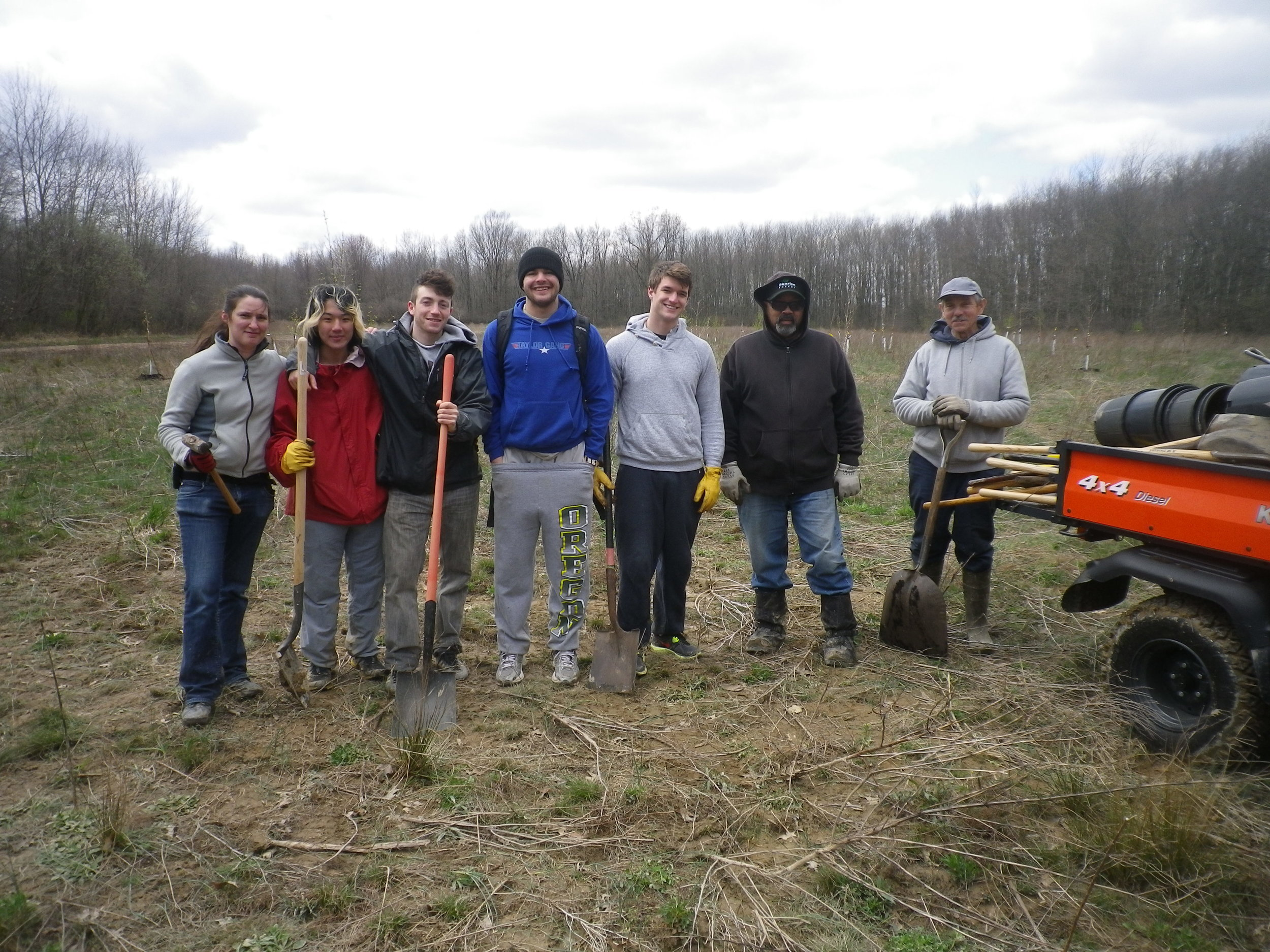 Student project organizers, volunteers and Oberlin College Grounds Staff planted trees to initiate the Afforestation Project.