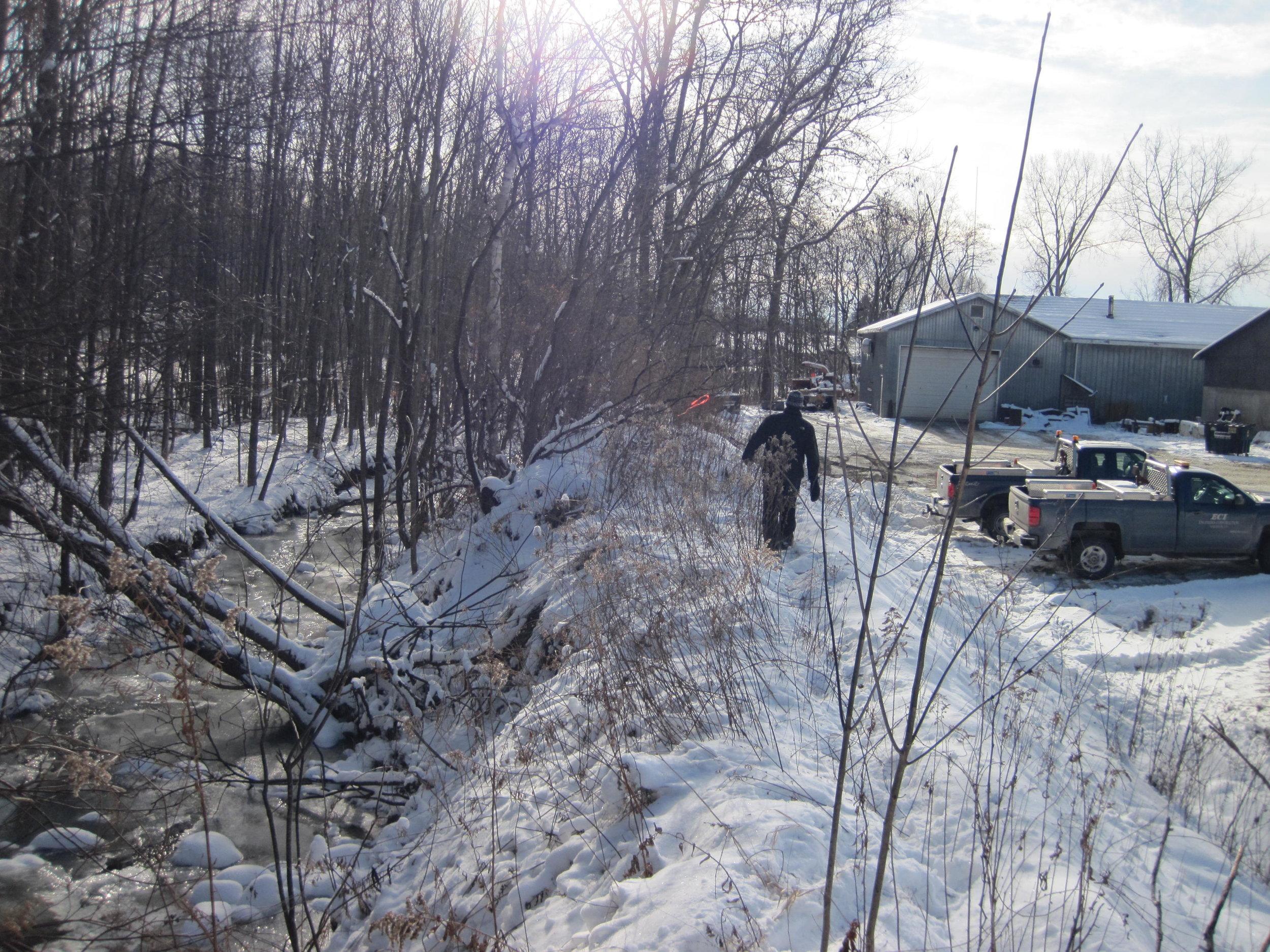 The berm between the Hinesburg garage site and Beecher Hill Brook