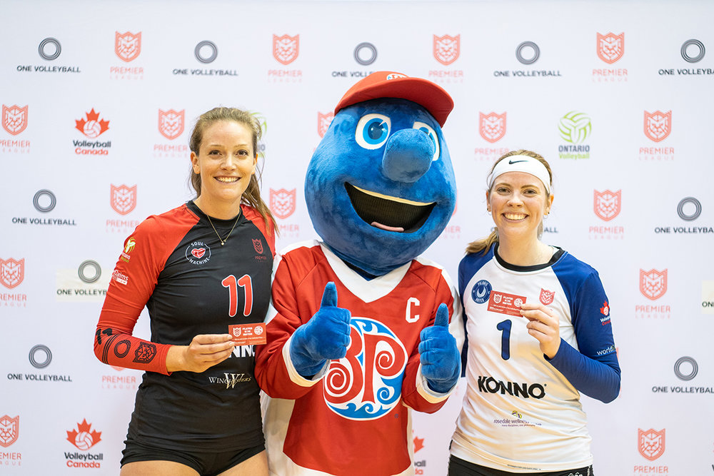 Toronto Premier Cup Women's Finals MVP's pose with Lionel from Boston Pizza with their Player of the Game pizza cards.