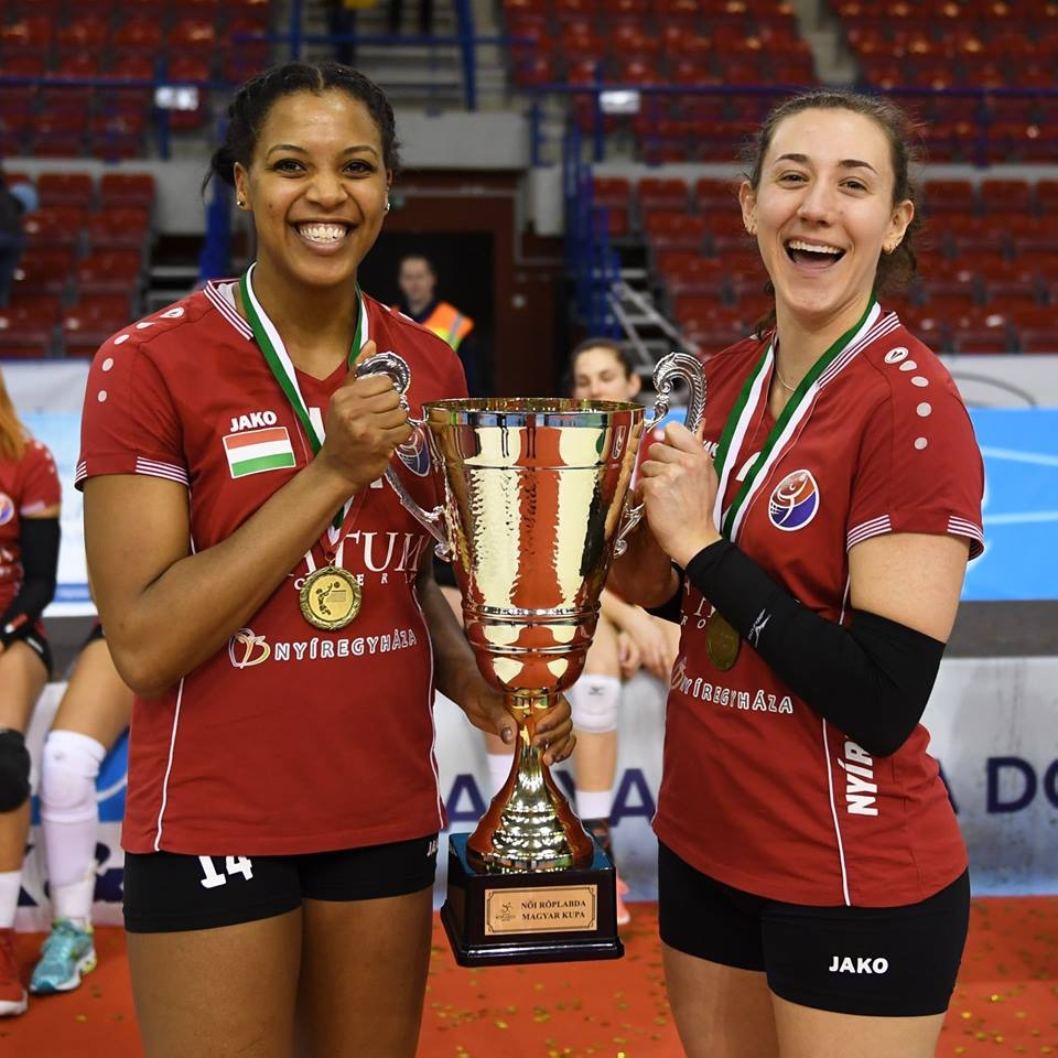 Jazmine White (left) and Danielle Brisebois (right) take a photo with the Hungarian Cup