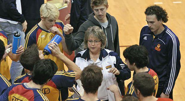 Brenda Willis coaching the Men's Volleyball team at Queen's University.