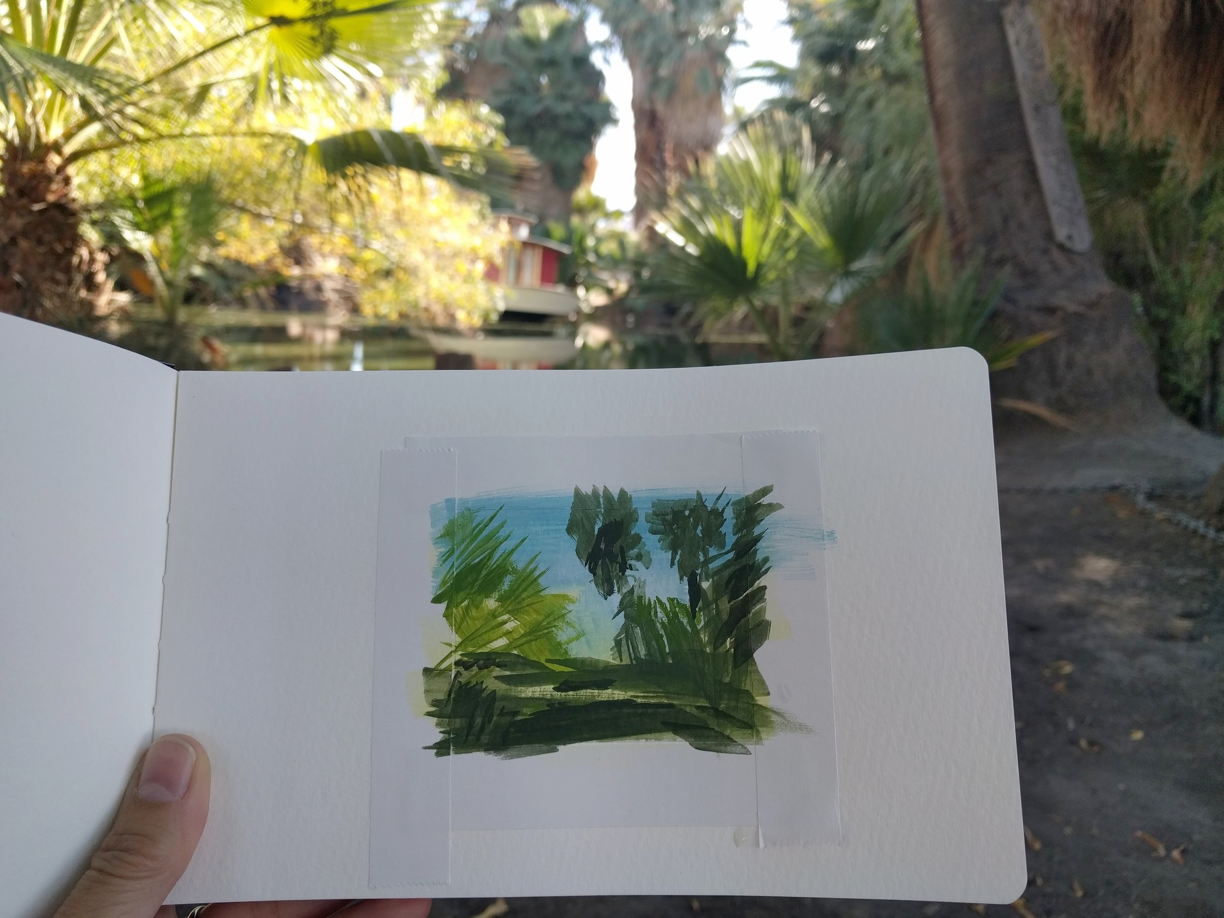 My Small Paintings miniature tiny art plein air watercolour painting of desert oasis with palm trees in 29 Palms Inn California, Sketchbook - progress view