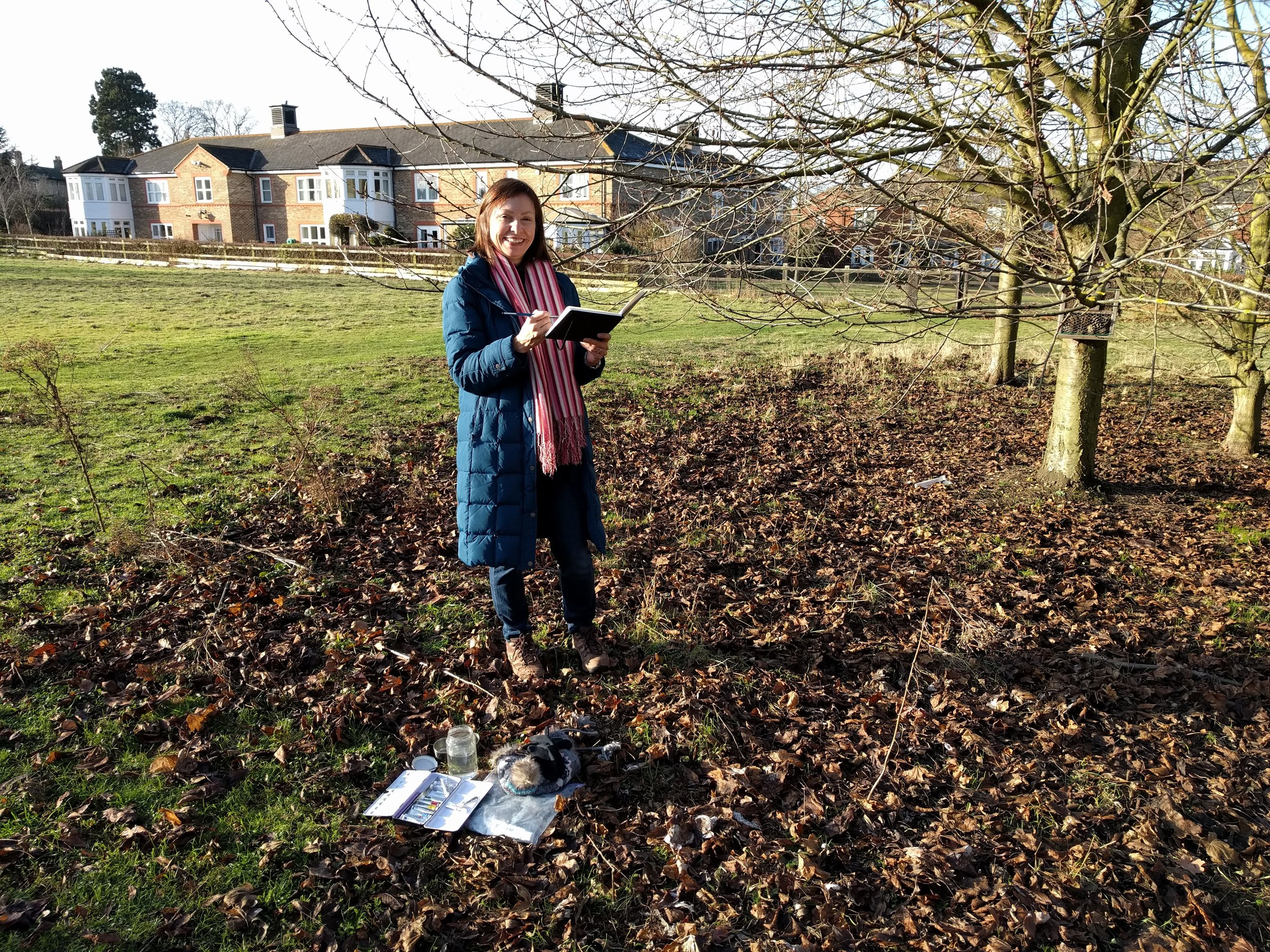 Artist miniaturist Amanda Em painting plein air in Girton, Cambridgeshire, for My Small Paintings