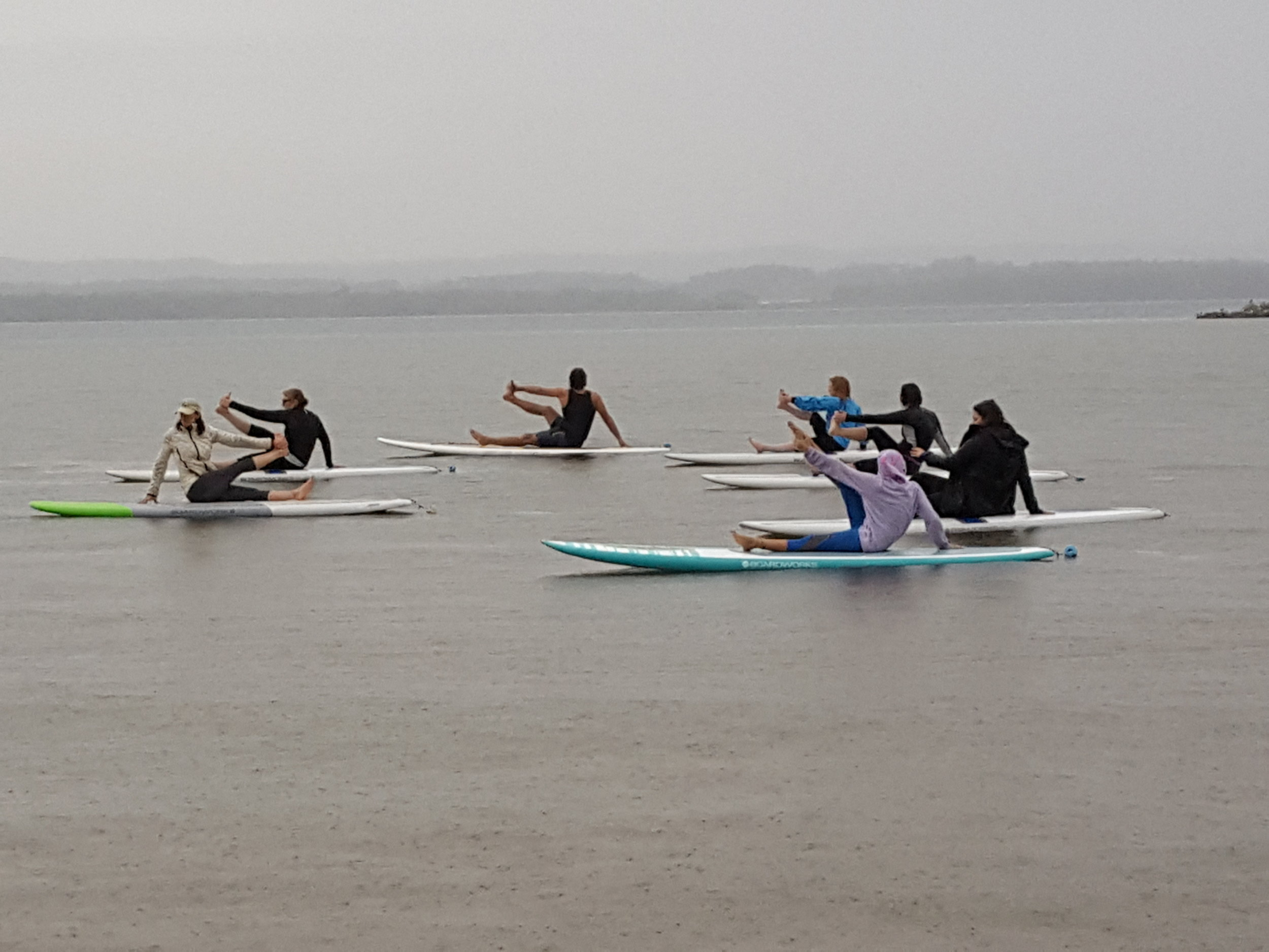 Rainy SUP seated twist.jpg