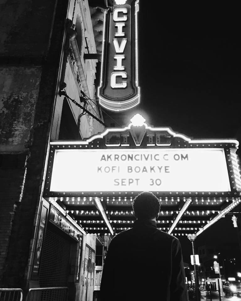 Kofi Boakye facing his marquee in front of the Akron Civic Theatre in Akron, OH. Photography courtesy of Bou-Jai Studios