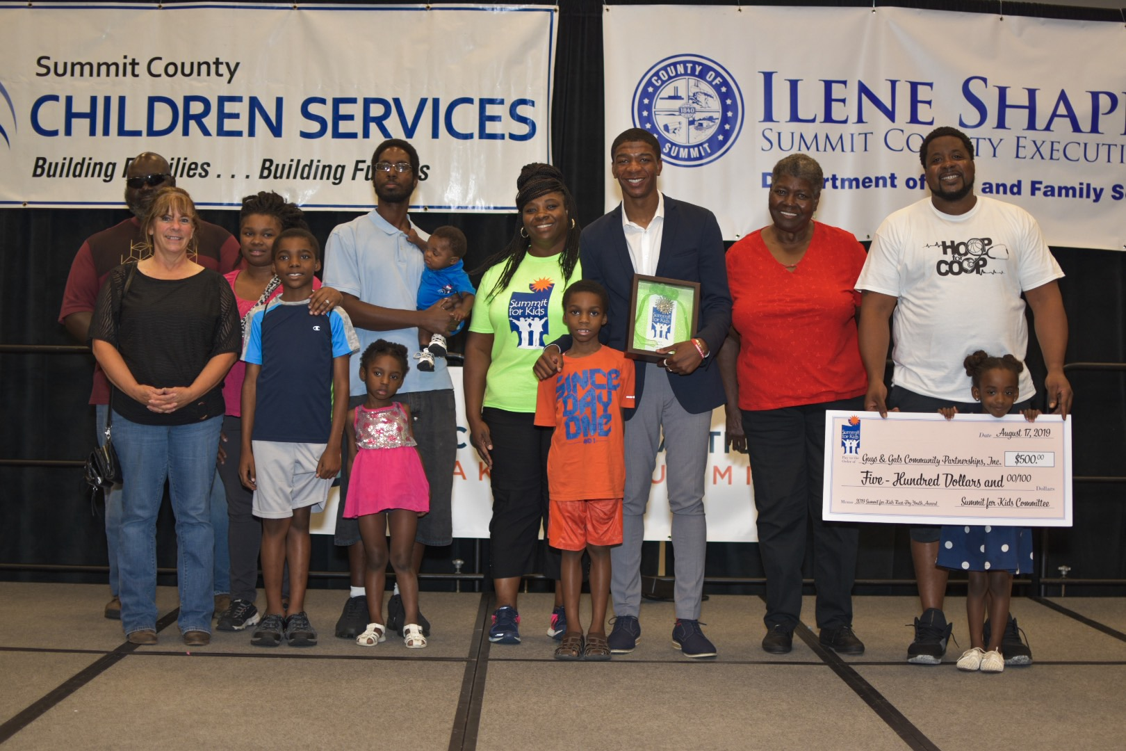 Kofi Boakye with Family and Executive Director Jerome Moss of Guys & Gals Community Partnerships