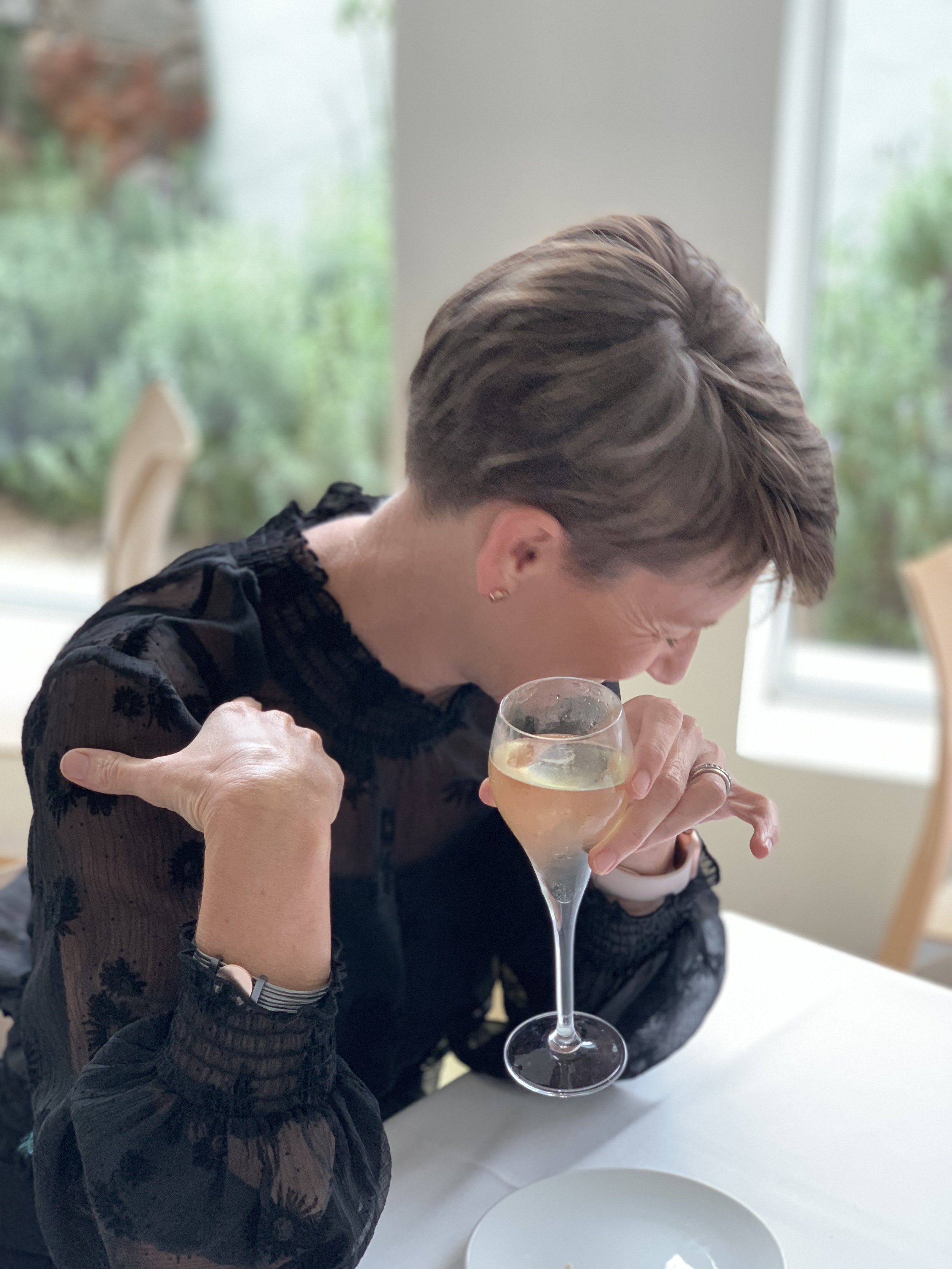 Me: laughing with Veuve at some nonsense my Mum came up with