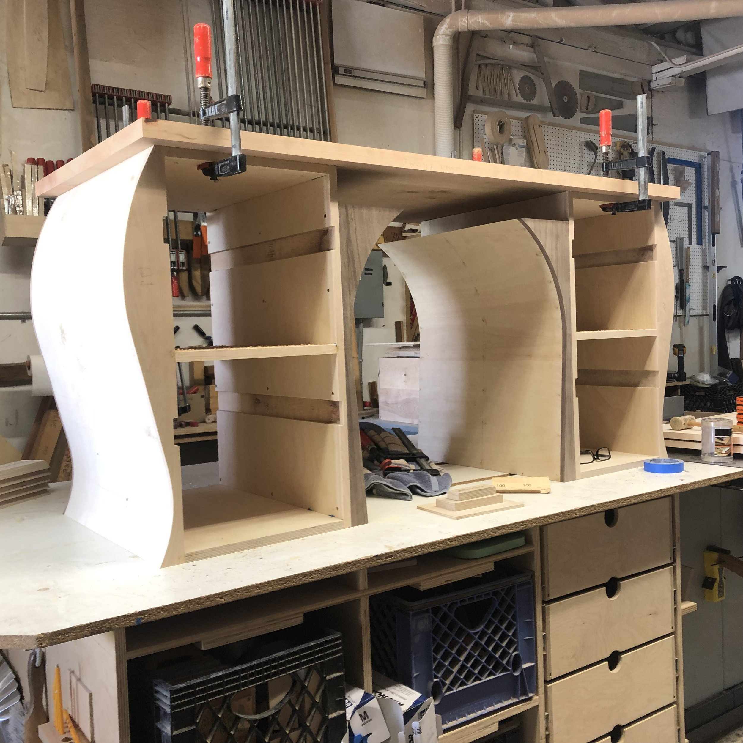 Recent Commission: Guitar-inspired desk - here showing the multiple custom bends of the sides and interior, topped with a solid cherry slab.