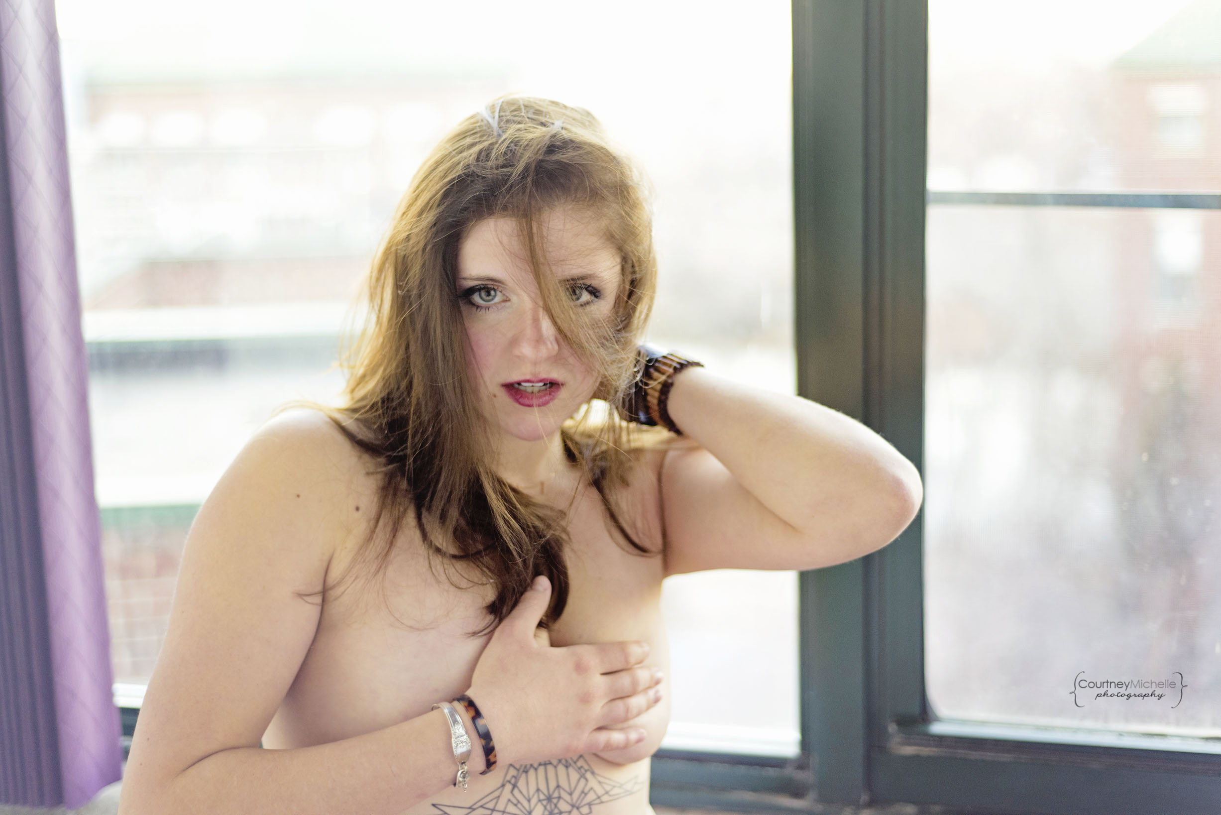 woman-backlit-in-front-of-big-windows-chicago-boudoir-photography-by-courtney-laper.jpg