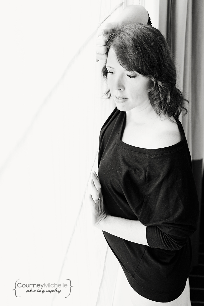 woman-in-black-shirt-next-to-window-light-and-curtains-chicago-boudoir-photography-by-courtney-laper.jpg