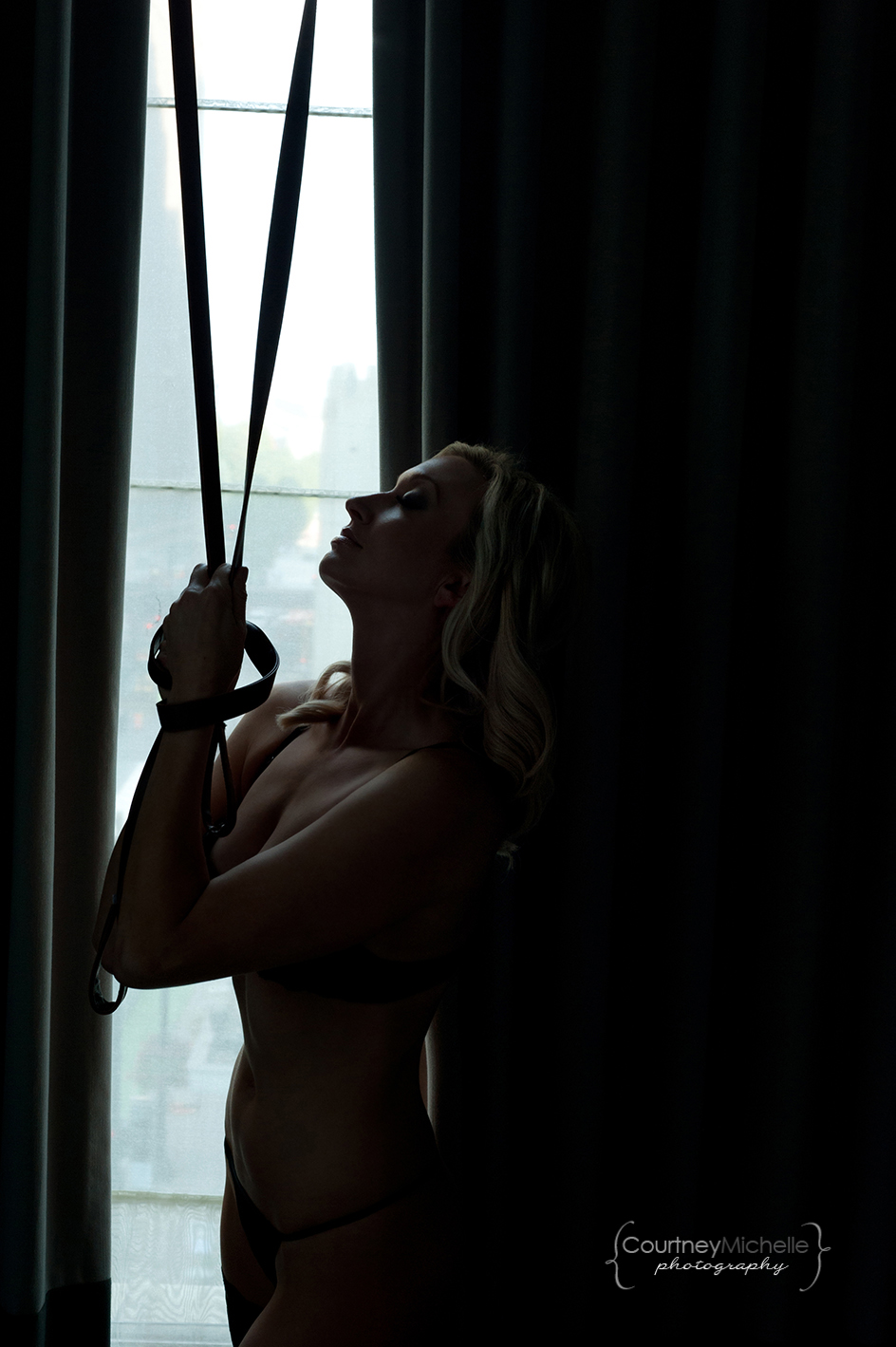 woman-in-lingerie-silhouette-next-to-window-light-and-curtains-chicago-boudoir-photography-by-courtney-laper.jpg