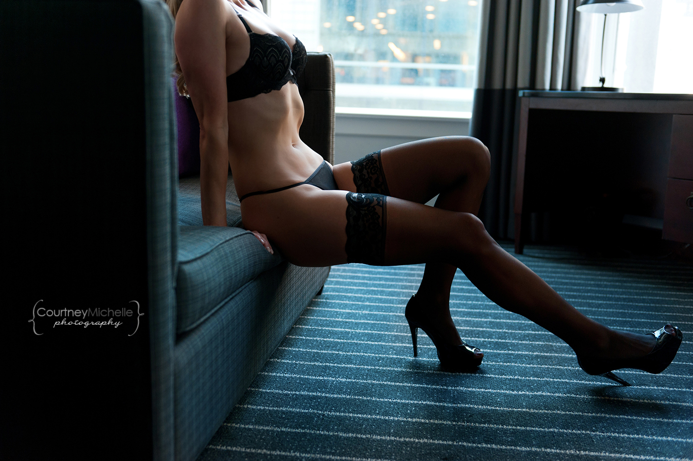 woman-in-lingerie-on-couch-in-hotel-living-room-chicago-boudoir-photography-by-courtney-laper.jpg