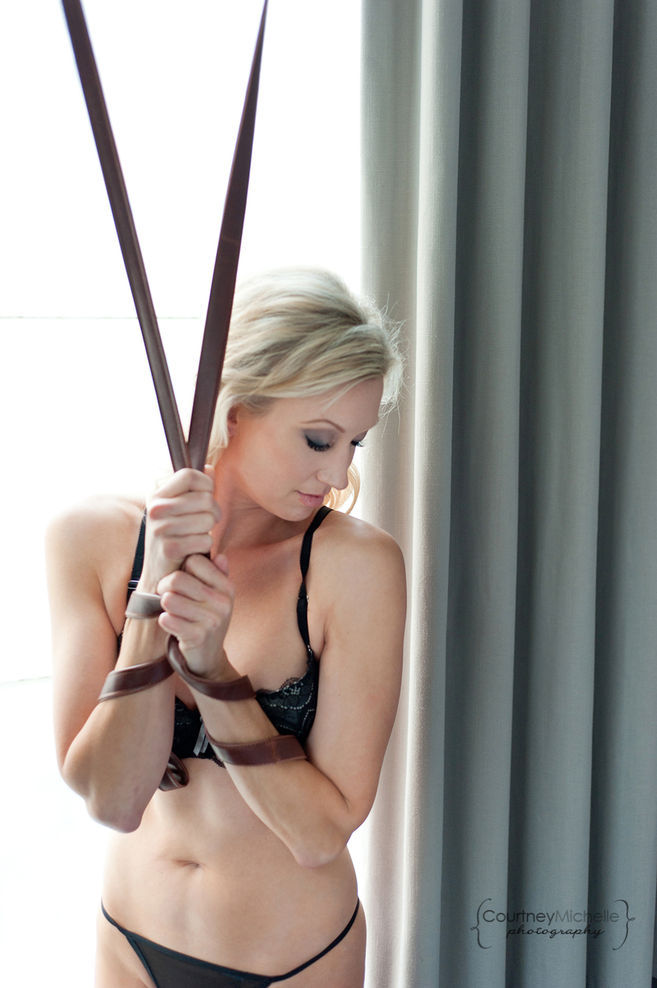 woman-in-lingerie-tied-wrists-next-to-window-light-and-curtains-chicago-boudoir-photography-by-courtney-laper.jpg