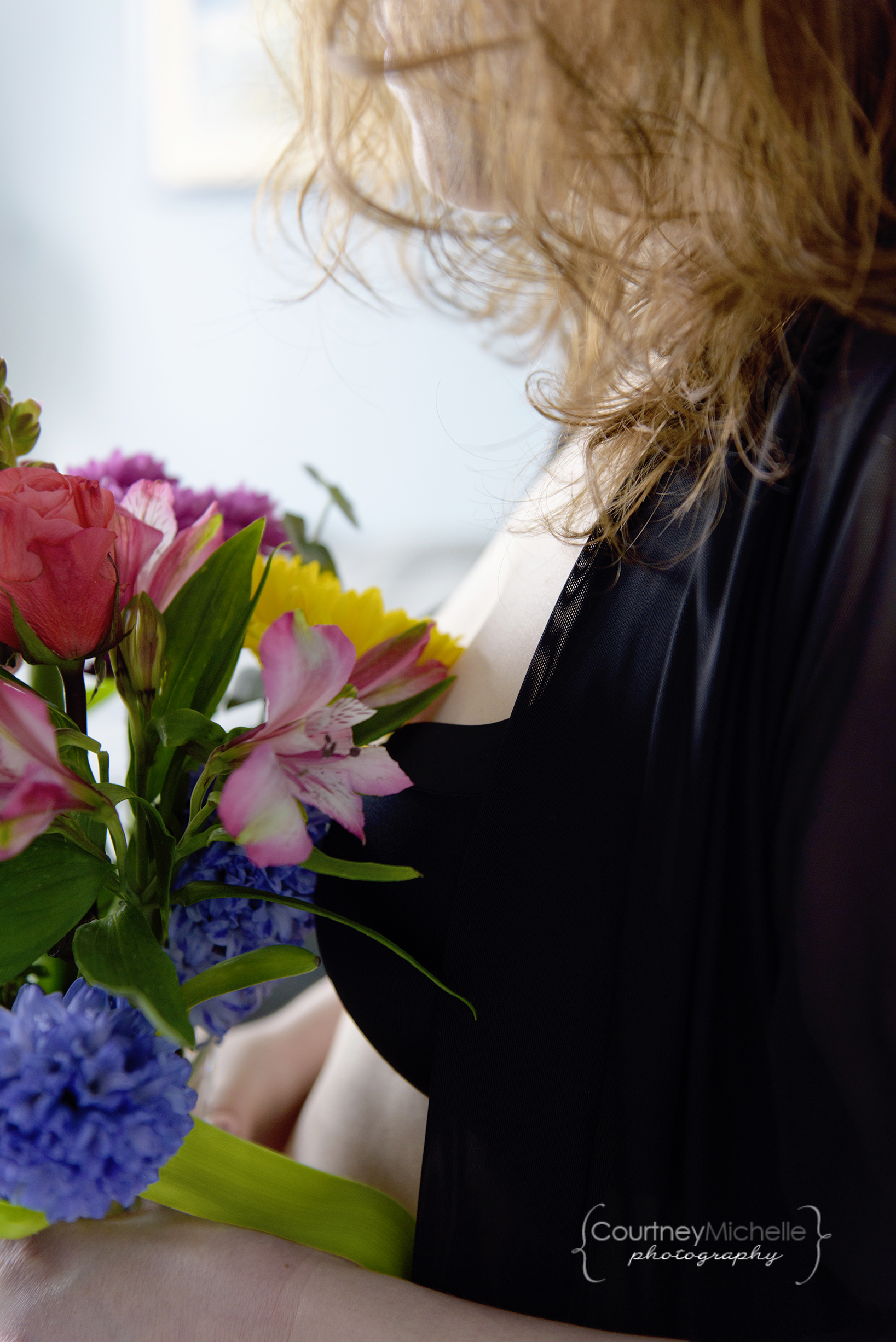 woman-in-robe-and-bra-with-spring-flowers-chicago-boudoir-photography-by-courtney-laper.jpg