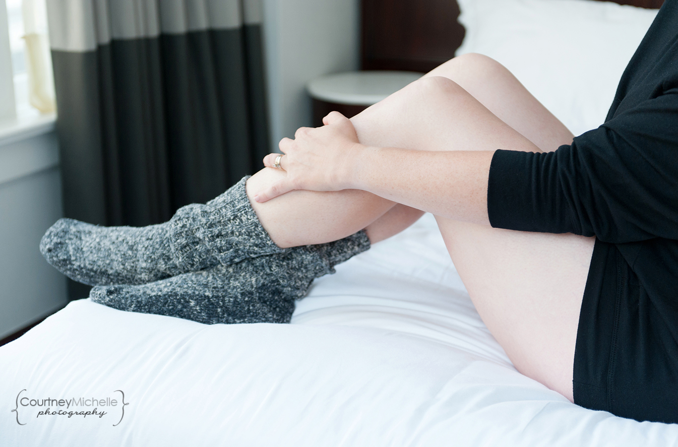 woman-legs-and-legwarmers-on-bed-chicago-boudoir-photography-by-courtney-laper.jpg