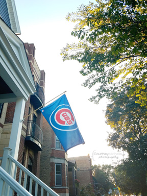 Most beautiful night for baseball! Flags everywhere while walking in my neighborhood to Wrigley.