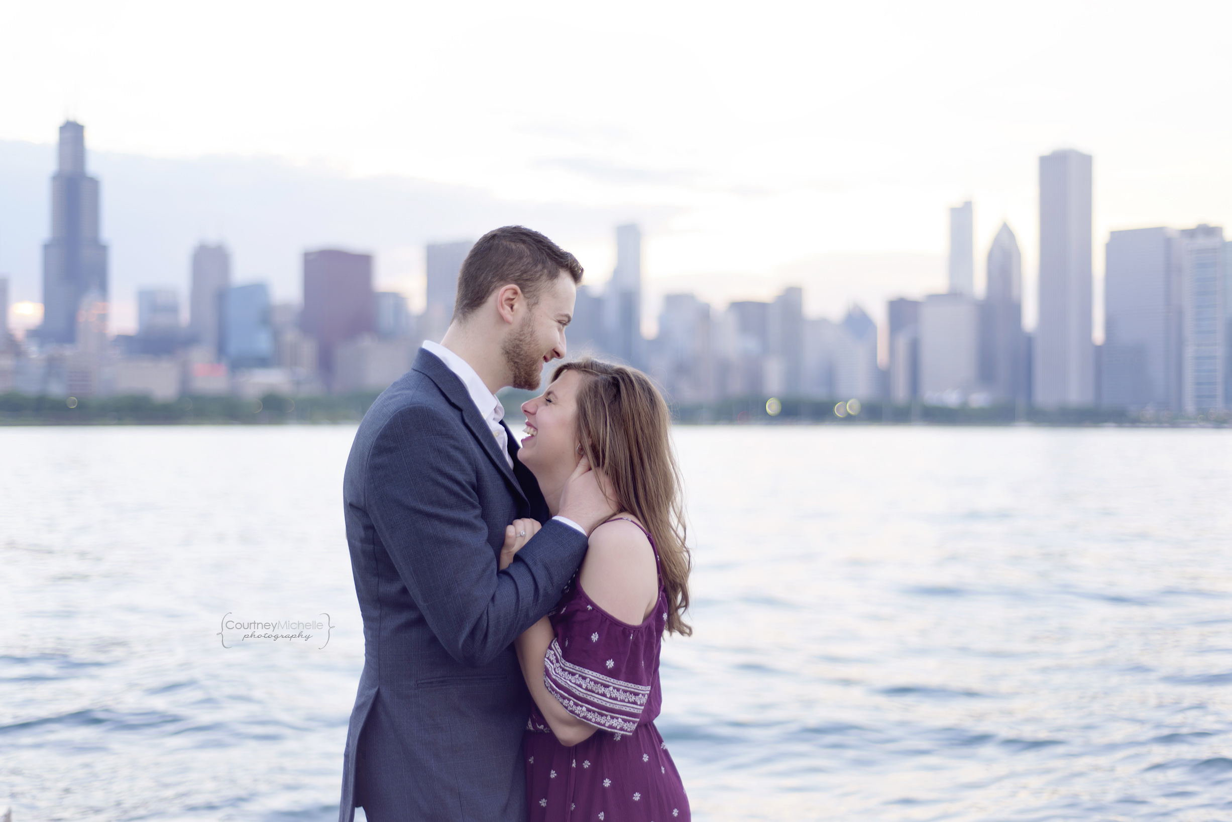 chicago-engagement-couple-laughing-skyline-at-sunset-adler-planetarium-engagement-photography-by-courtney-laper.jpg