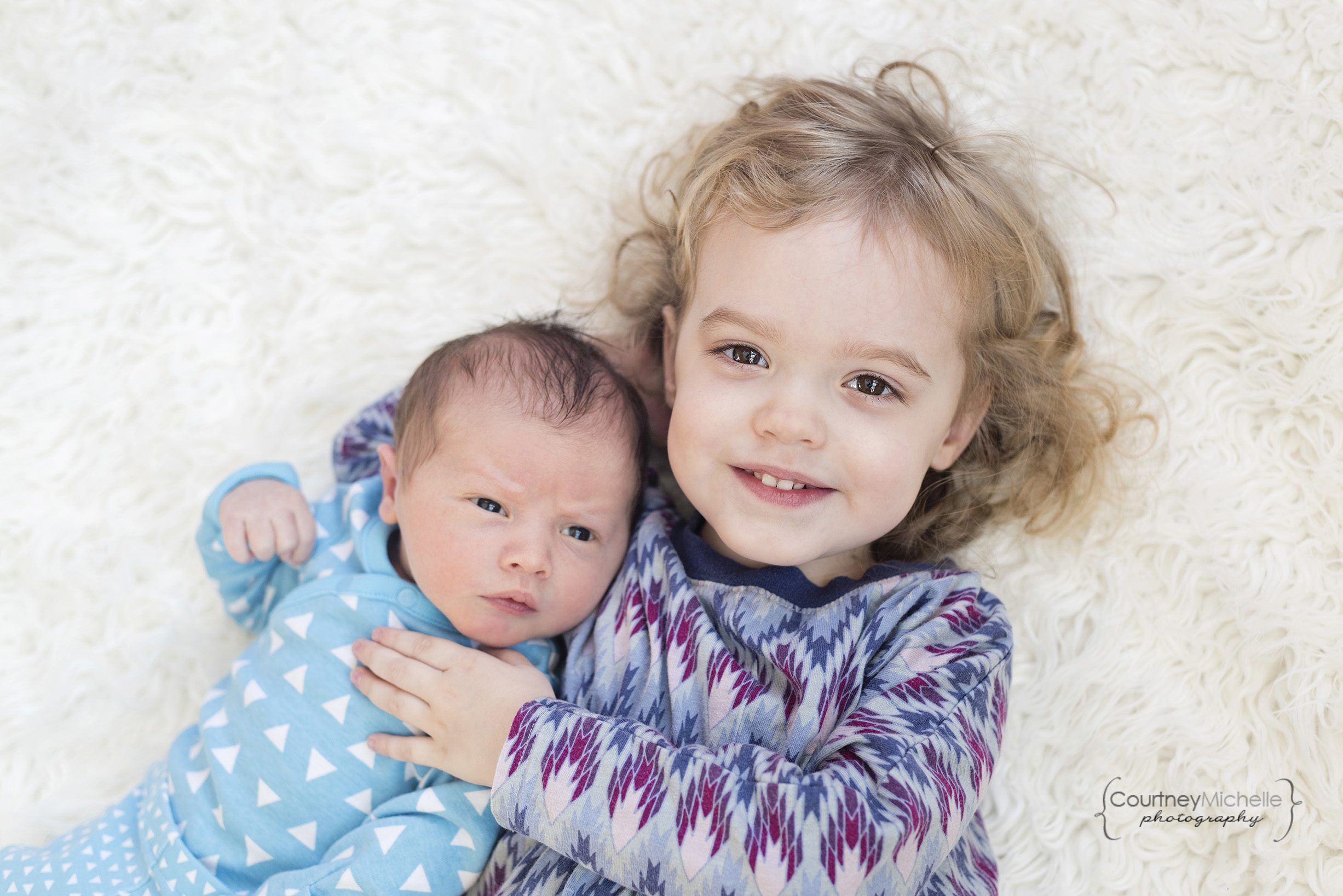 newborn-baby-boy-and-big-sister-on-white-fur-siblings-chicago-newborn-lifestyle-photography-by-courtney-laper.jpg