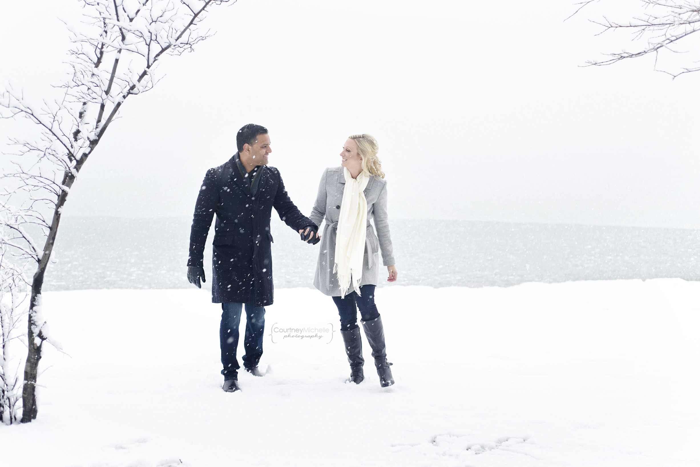 snowy-chicago-engagement-photography-museum-campus-walking-lake-michigan-holding-hands-in-snow-courtney-laper©COPYRIGHTCMP-3451.jpg