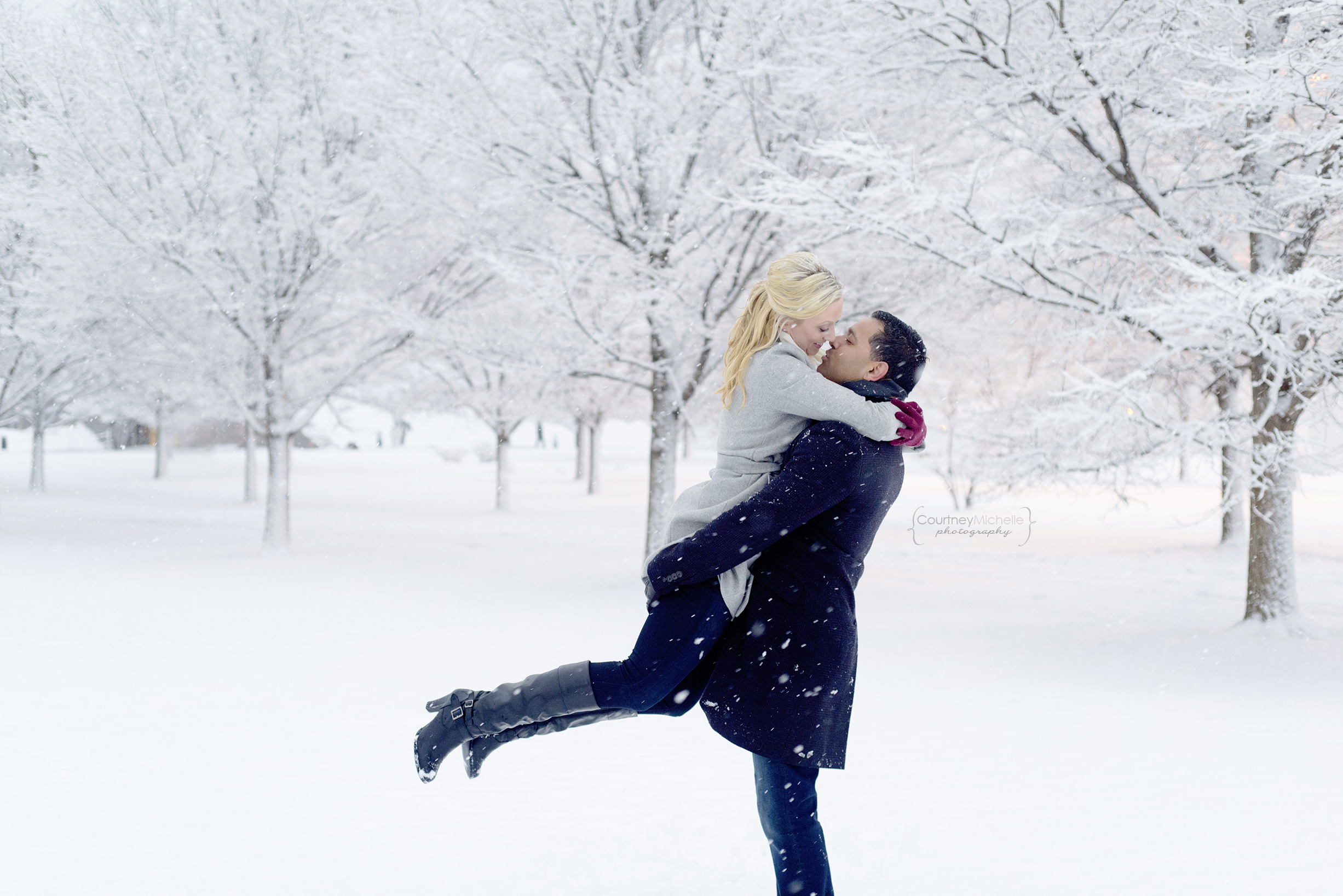 snowy-chicago-engagement-photography-museum-campus-twirling-in-snow-courtney-laper©COPYRIGHTCMP-3521.jpg