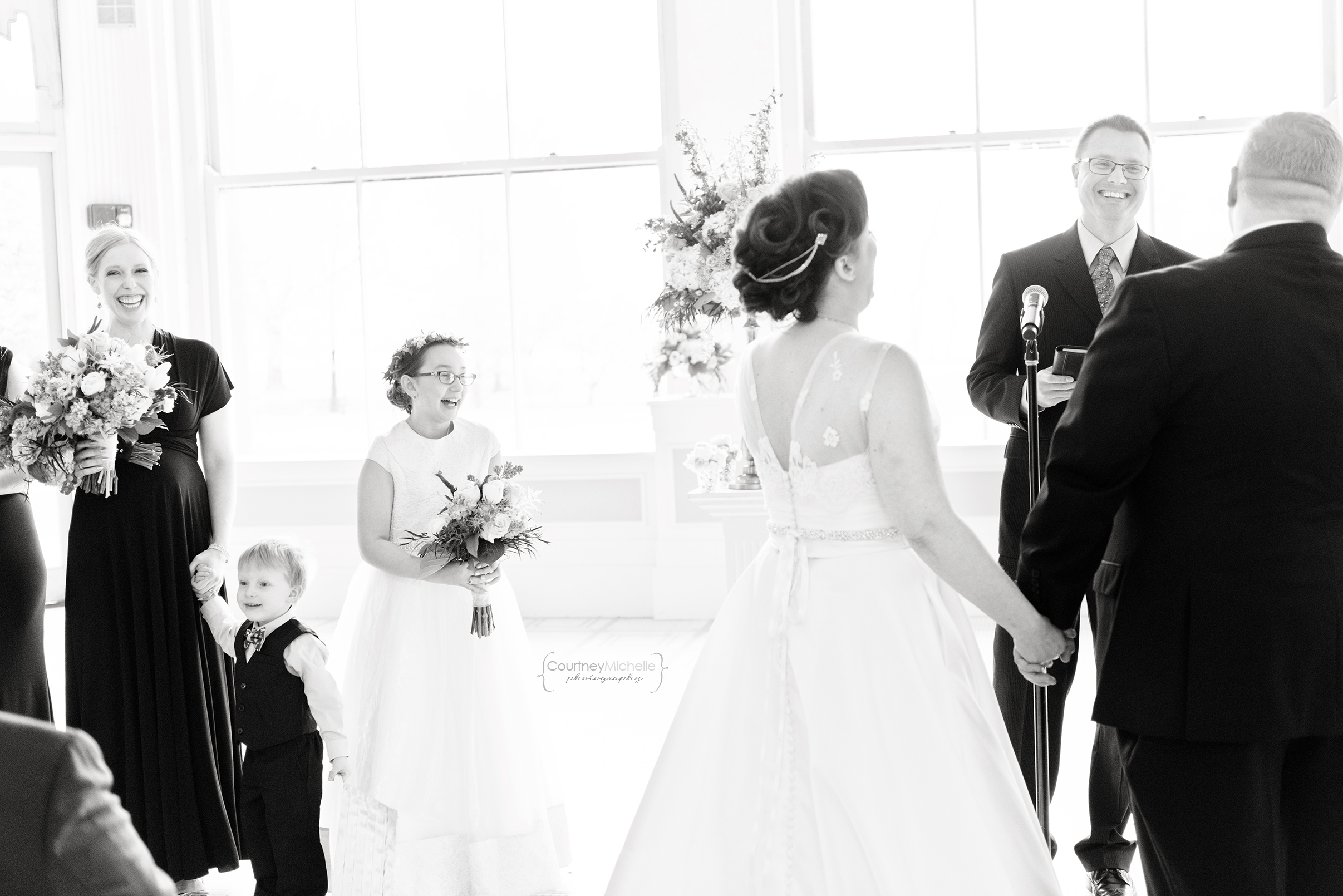 chicago-wedding-photographer-south-shore-cultural-center-ceremony-laughing