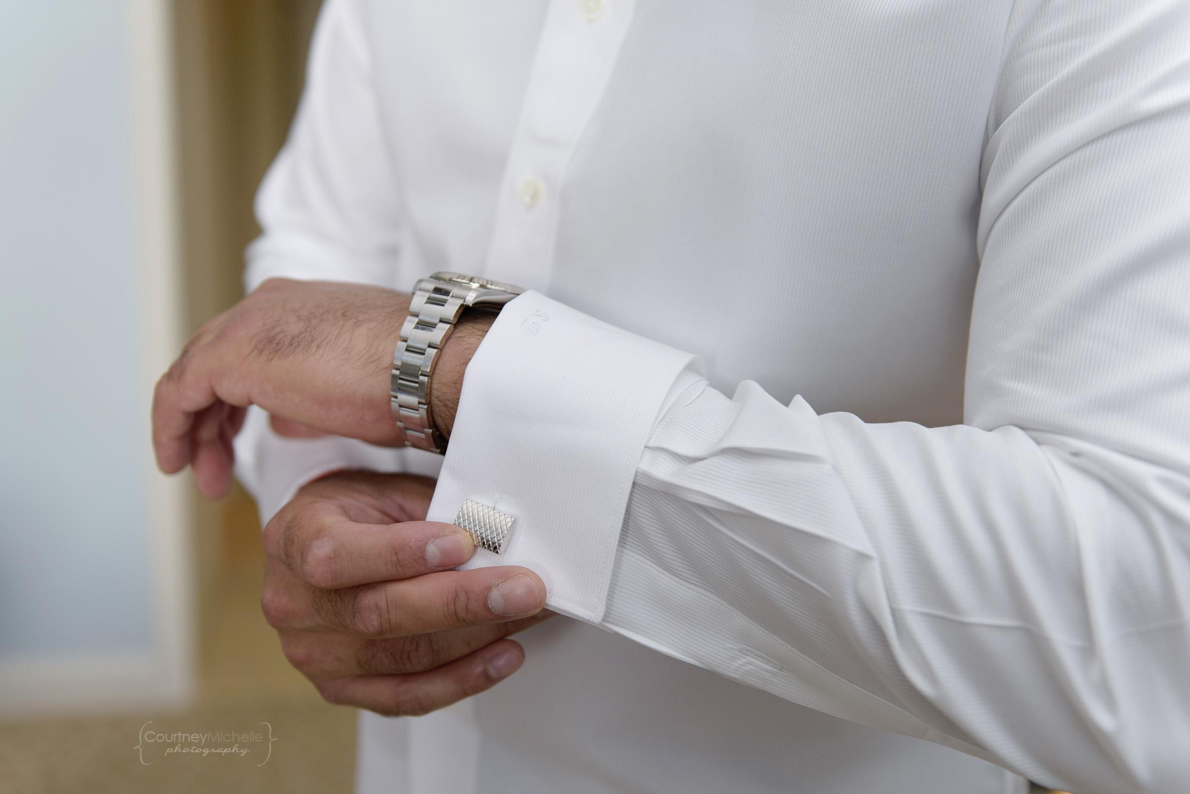 groom-putting-cufflinks-on-grand-cayman-beach-wedding-photography-by-courtney-laper©CopyrightCMP-LeaAnneRaj-7479.jpg