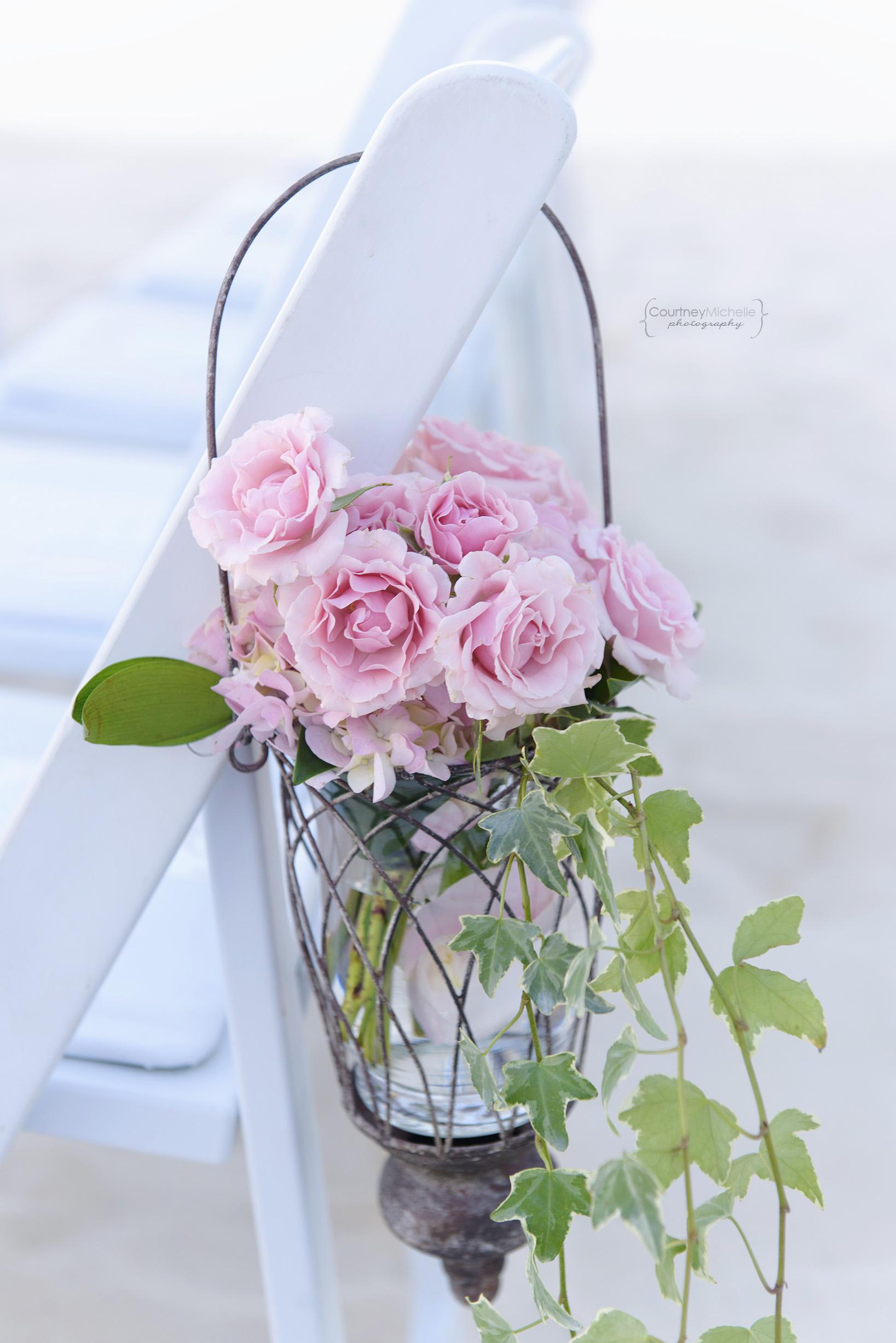 aisle-flower-decor-grand-cayman-beach-wedding-photography-by-courtney-laper©CopyrightCMP-LeaAnneRaj-7634.jpg