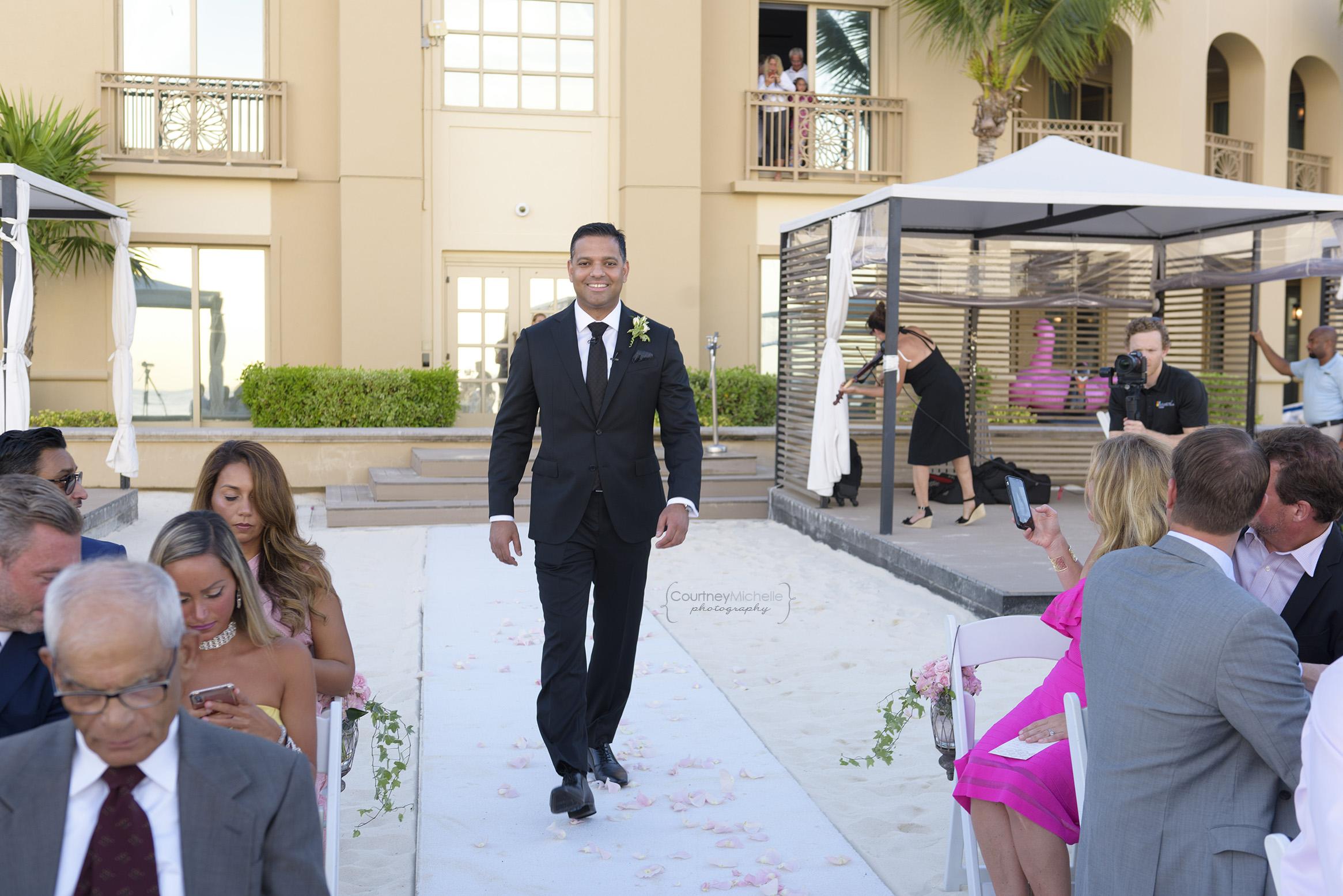groom-walking-down-the-aisle-grand-cayman-beach-wedding-photography-by-courtney-laper©CopyrightCMP-LeaAnneRaj-7646.jpg