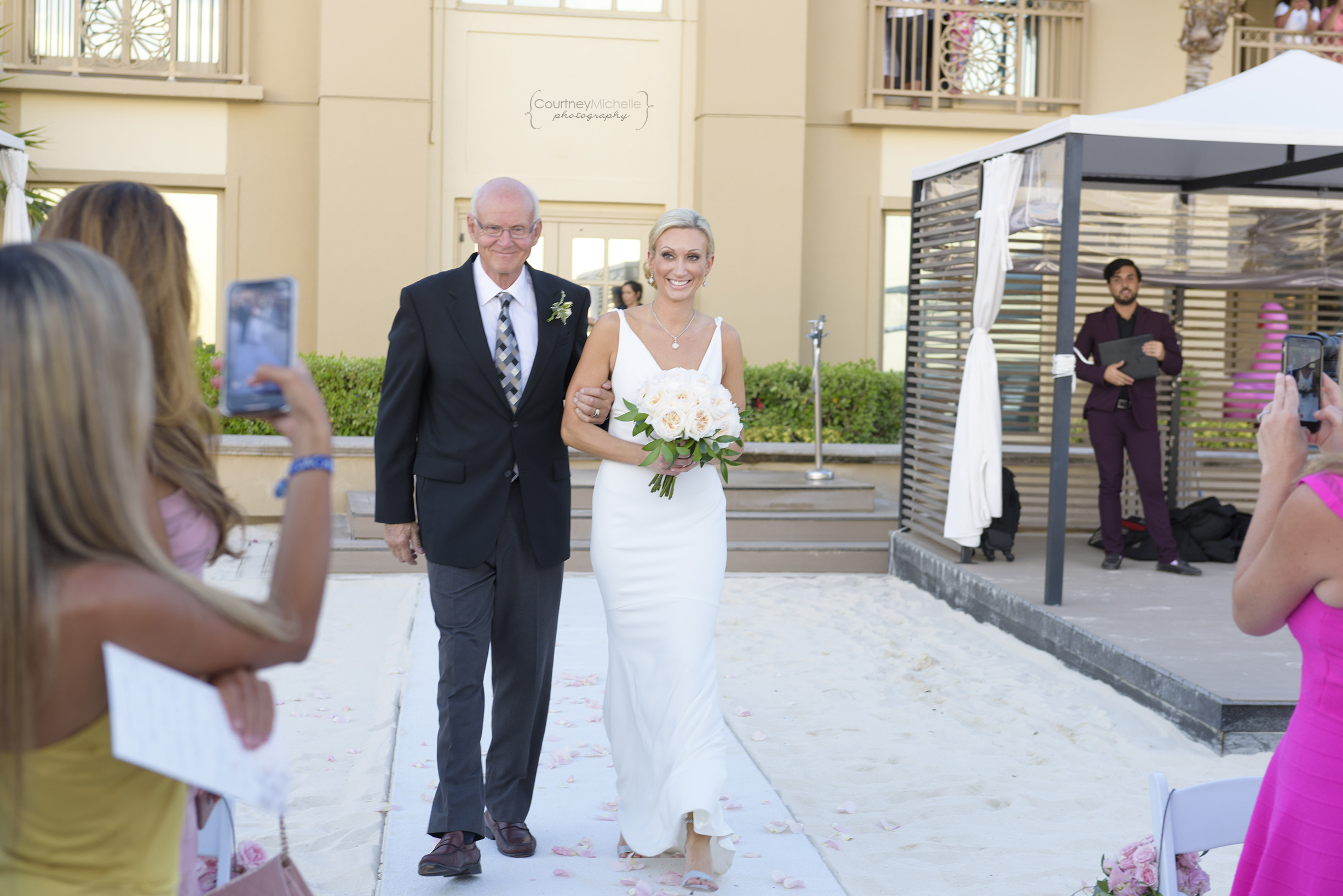 bride-walking-down-aisle-with-father-grand-cayman-beach-wedding-photography-by-courtney-laper©CopyrightCMP-LeaAnneRaj-7704.jpg