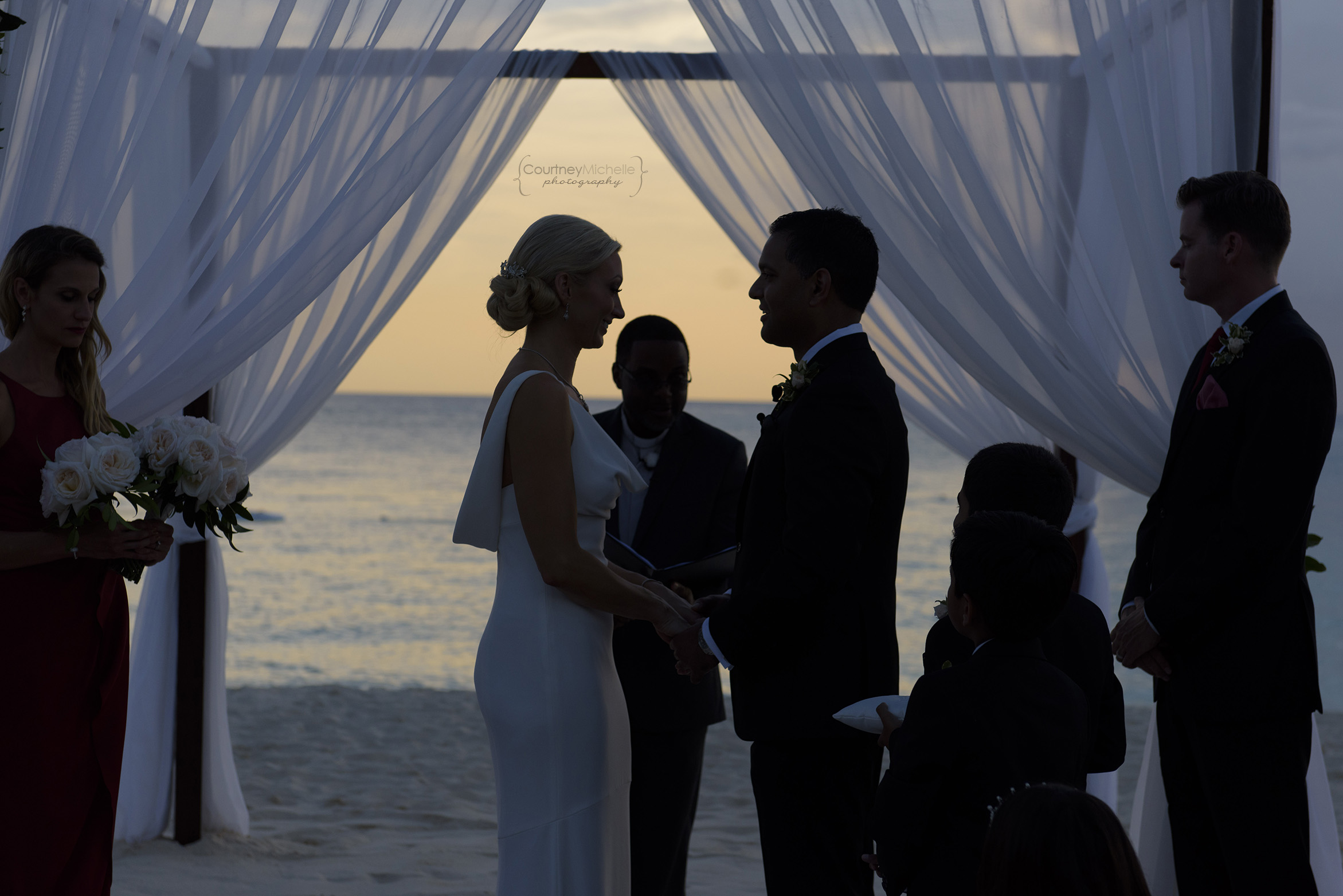 bride-and-groom-silhouette-grand-cayman-beach-wedding-photography-by-courtney-laper©CopyrightCMP-LeaAnneRaj-7741.jpg