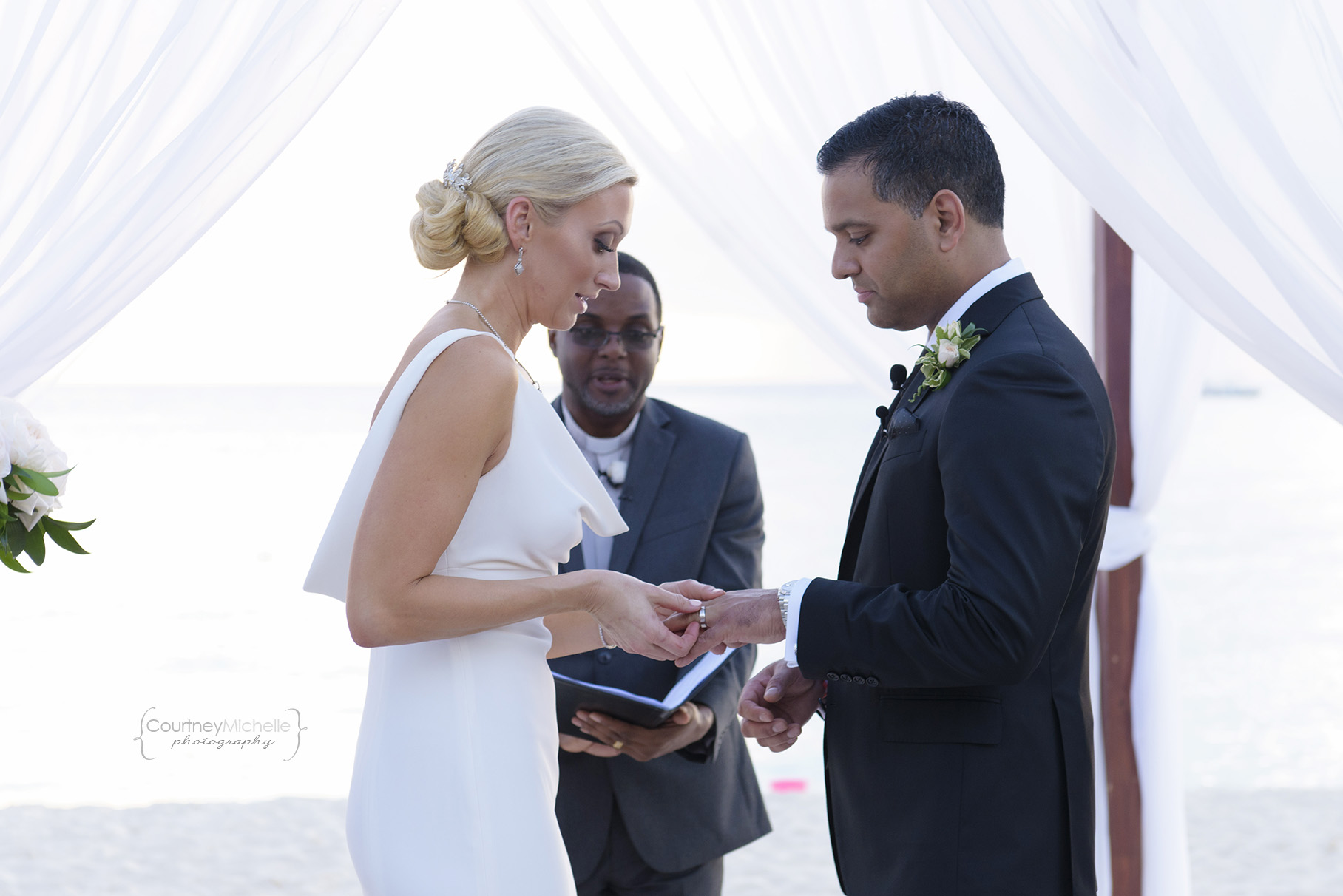 ring-exchange-grand-cayman-beach-wedding-photography-by-courtney-laper©CopyrightCMP-LeaAnneRaj-7764.jpg