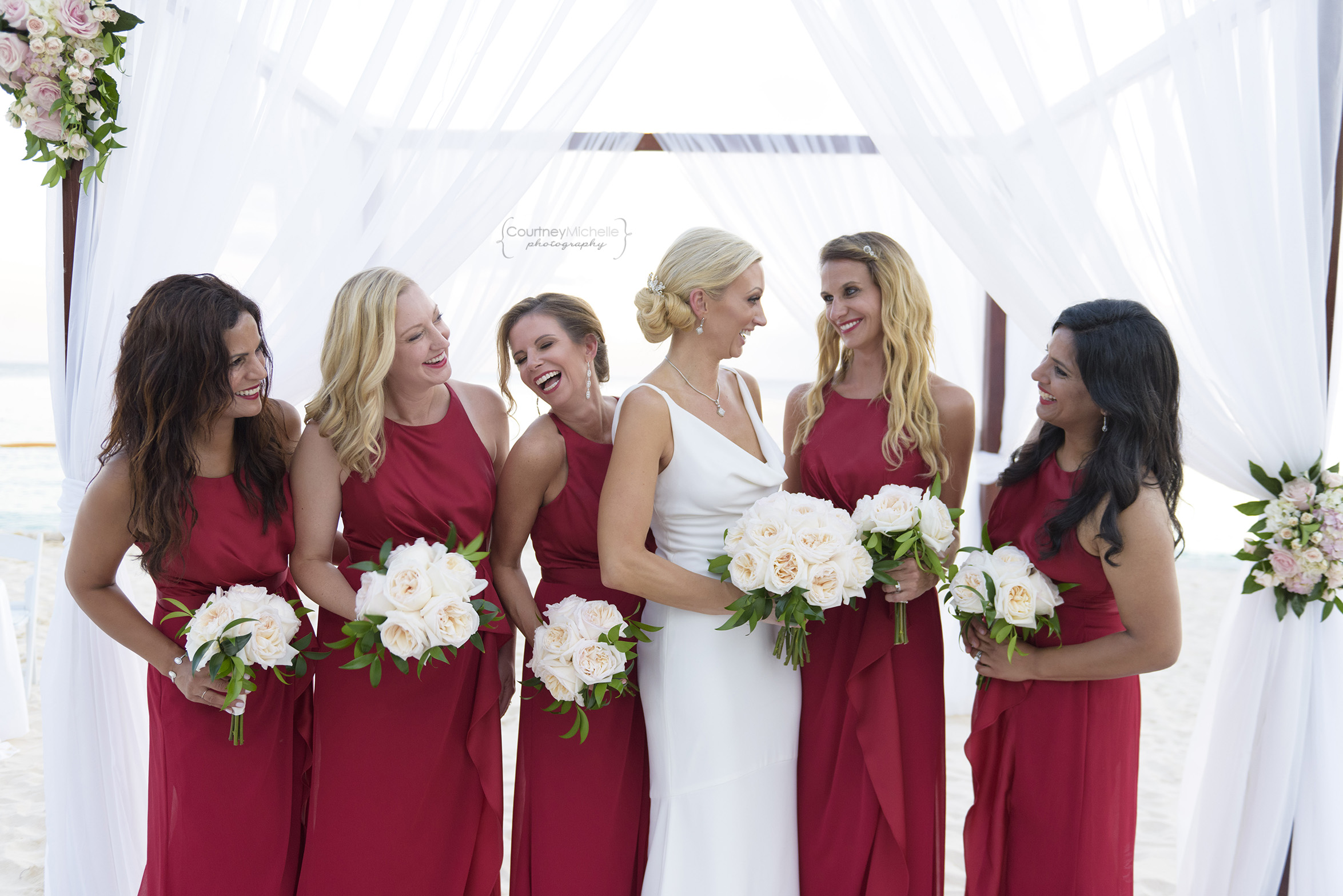 bride-and-bridesmaids-grand-cayman-beach-wedding-photography-by-courtney-laper©CopyrightCMP-LeaAnneRaj-7924.jpg