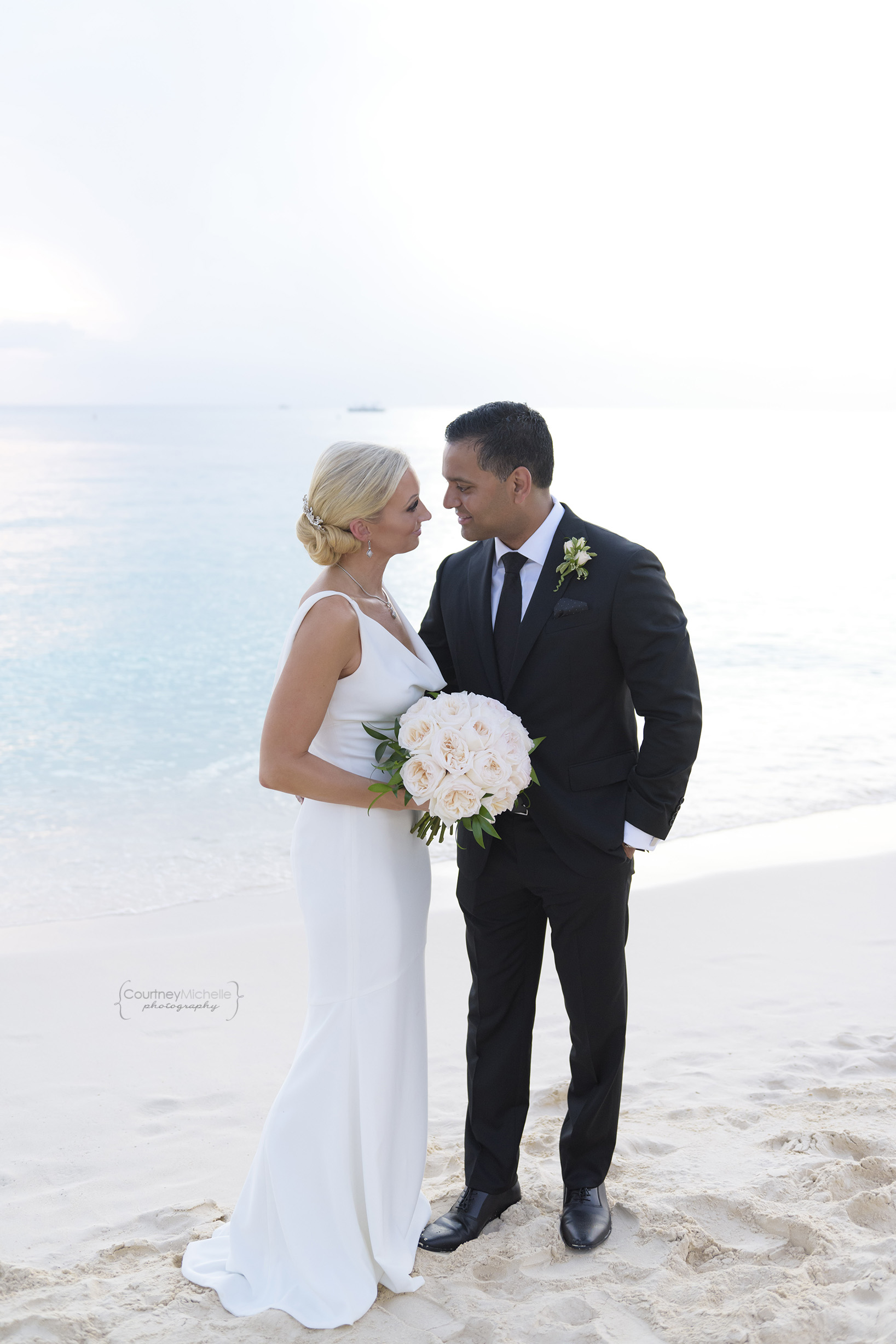 bride-and-groom-portrait-grand-cayman-beach-wedding-photography-by-courtney-laper©CopyrightCMP-LeaAnneRaj-7963.jpg