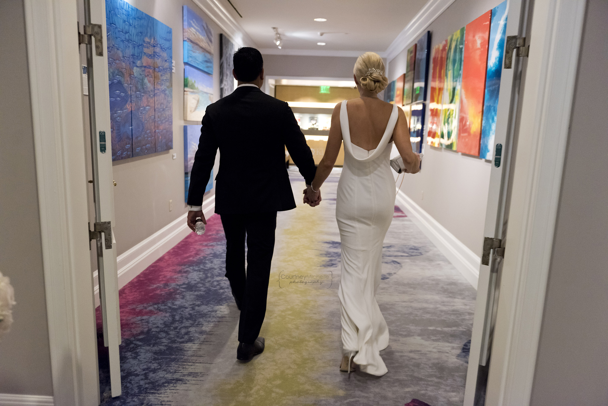 bride-and-groom-walking-to-reception-grand-cayman-beach-wedding-photography-by-courtney-laper©CopyrightCMP-LeaAnneRaj-8052.jpg