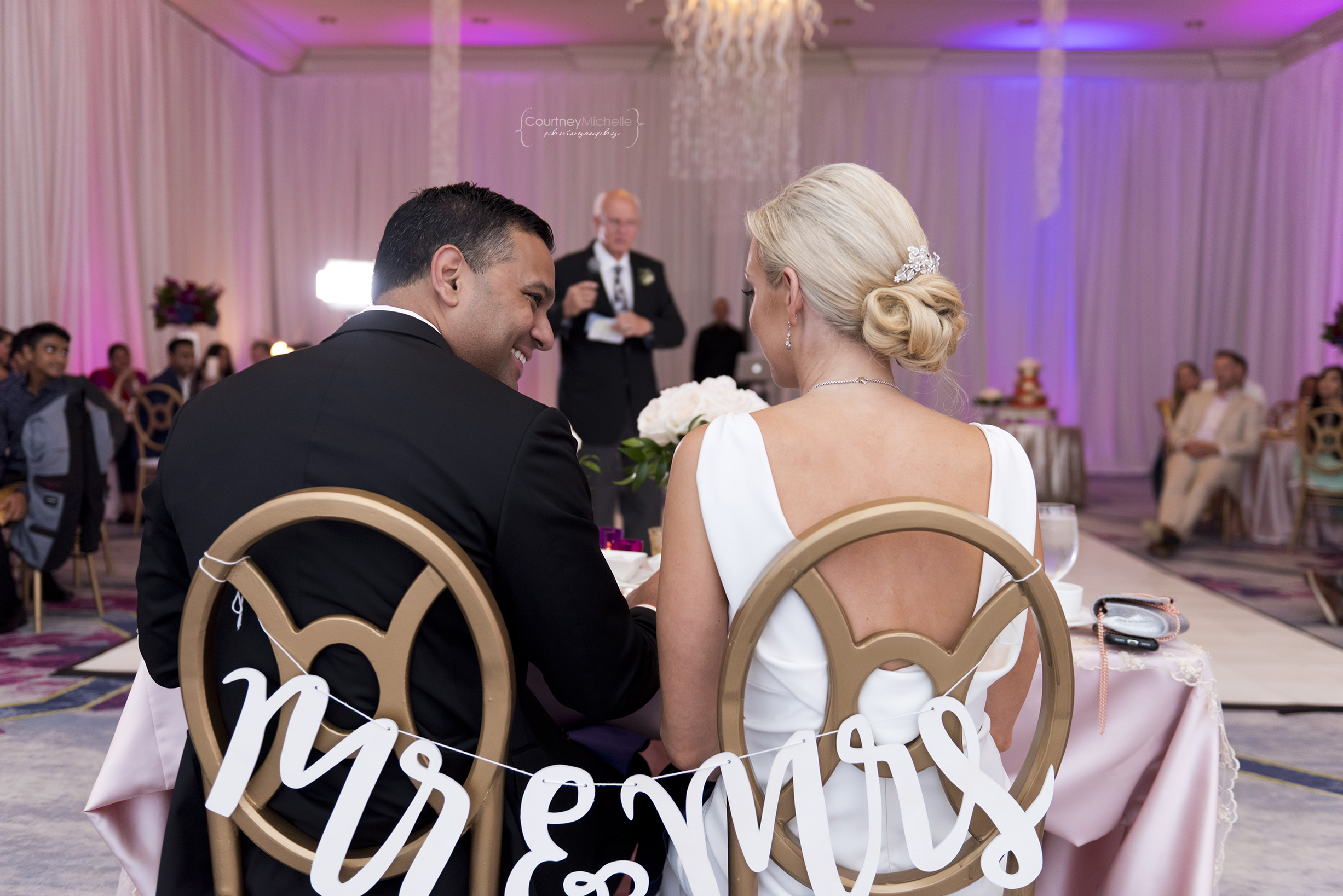 bride-and-groom-listening-to-toasts-portrait-grand-cayman-beach-wedding-photography-by-courtney-laper©CopyrightCMP-LeaAnneRaj-8313.jpg