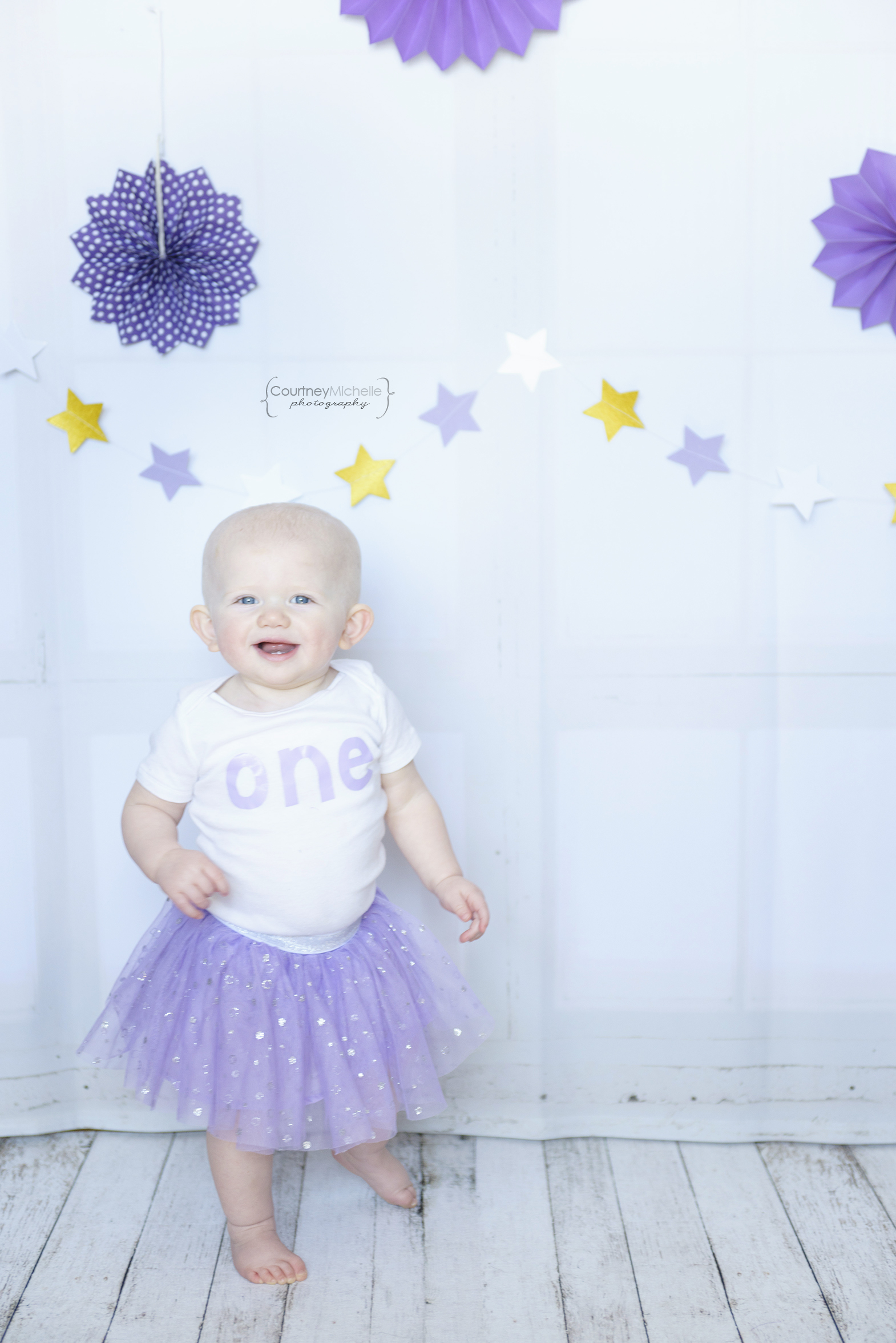 ©CourtneyMichellePhotography_spring_one_year_old_birthday_purple_tulips_2082.jpg