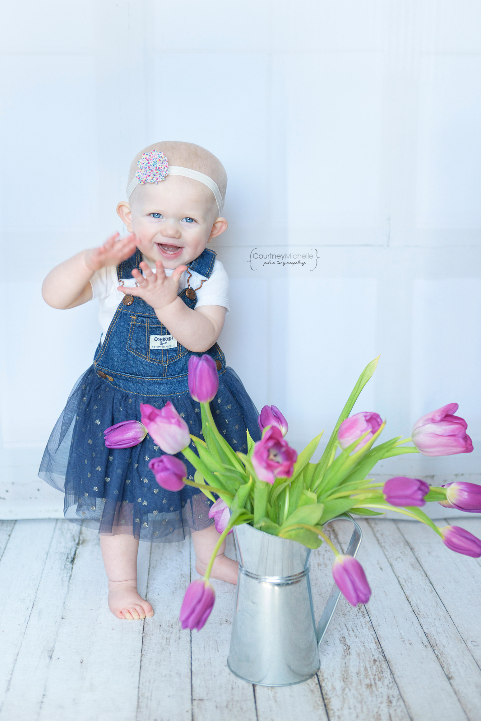 ©CourtneyMichellePhotography_spring_one_year_old_birthday_purple_tulips_2134.jpg
