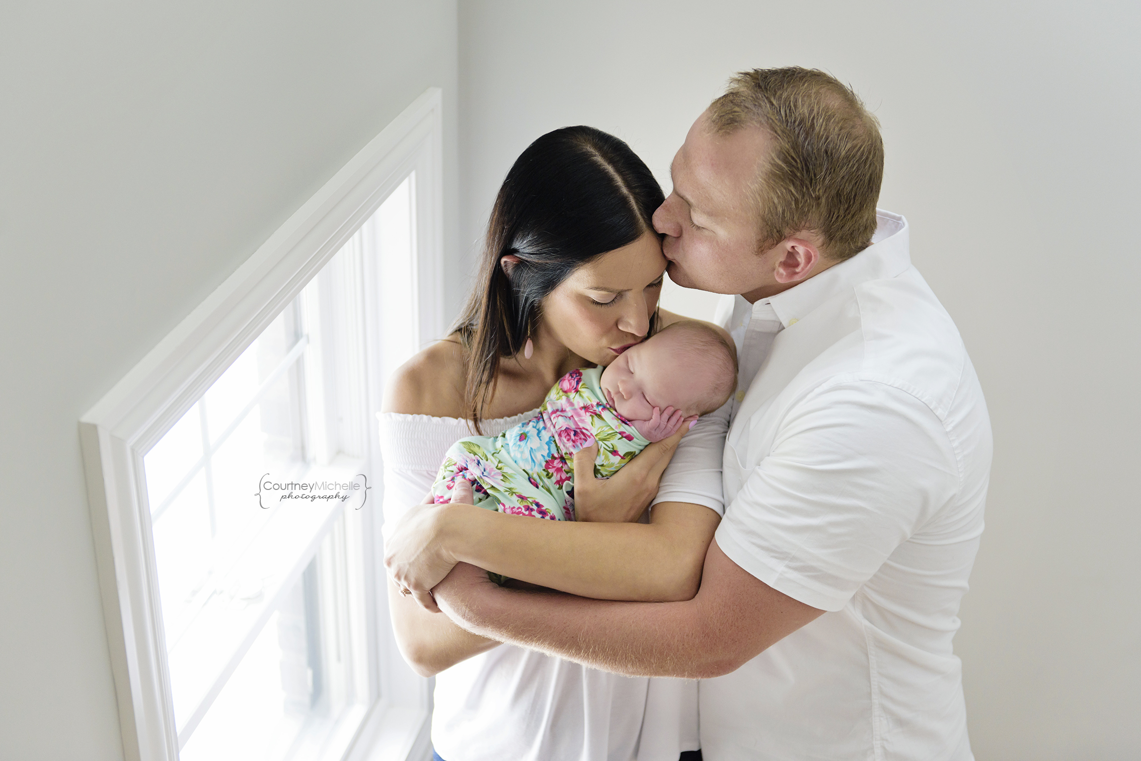 chicago-newborn-photographers-courtney-laper-lifestyle-session-mom-holding-down-syndrome-baby-girl-dad-kissing-mom-COPYRIGHTCMP-Camille20190705-2749-50.jpg