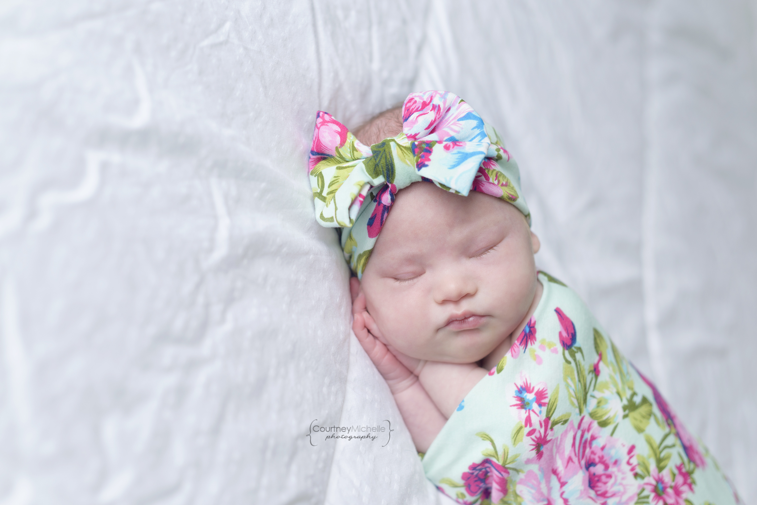 chicago-newborn-photographers-courtney-laper-lifestyle-session-down-syndrome-newborn-baby-girl-swaddled-on-bedCOPYRIGHTCMP-Camille20190705-2705-30.jpg
