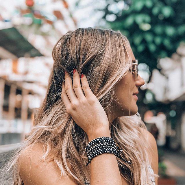 This beauty @intotheshallows wearing our Good Karma & Silver FIESTA bracelets. Spreading goodness & kindness wherever she travels. Link in profile. . . . . . . . . #handmade #handmadejewelry #margaritas #bohojewelry #bohobracelet #fashionblogger #yoga #bohemian #bohemianjewelry #handcrafted #gypsy #globalswag #agate #vegan #beachjewelry #turquoisejewelry #bohochic #beachchic #pearls  #saltyarrow #gypset #wanderlust  #bohostyle  #wildandfree