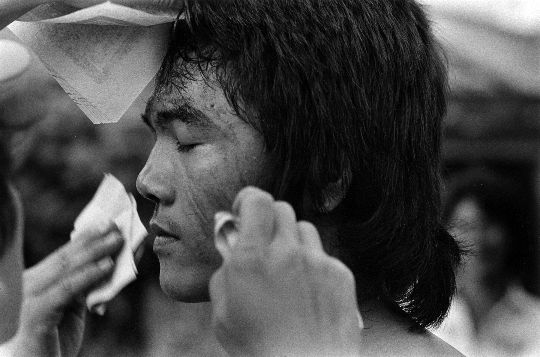 In 1985, Tom Ferentz travelled to Taiwan to exhibit his photographs at the American Cultural Center Gallery in Taipei. Through the exhibition, he got to know several photographers. He joined some to visit a small town outside of Kao Hsiang, which was having a ceremonial day. The whole town was involved. Parades with dancers traversed the streets. Occasionally, they stopped to deeply breathe in smoke from pots with sticks of some kind of incense. It appeared to augment their dancing and they entered a trance-like state. Stylized martial arts-like movements were augmented by flagellation: striking themselves on the back with thorny objects, drawing blood.  Children participated in the procession, not the flagellation. Monitors closely watched each one. They had an intense concern for the children.  Tom Ferentz is Founder and Artistic Director of Sixth Street Photography Workshop and 6th On 7th Gallery. In those days, he was more or less a documentary style photographer. Since, he branched out to other areas, including poetic narrative  photo-text  pieces, theatrical figure studies and the writing of fiction.  In Taiwan 1995  was photographed with film.