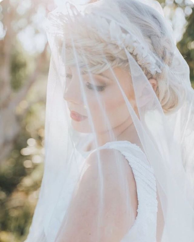 "Veiled treasures 🕯 The ""Angel Aura"" Quartz crown on @brookestyless • epic intricate hair styling by @thefoxanddandelion and captured so beautifully by @mallorysparklesphoto 💫 All vendors listed below:  MU @sunshinebrides  Concept & Cake @wildchildcakes  Flowers @bloodwoodbotanica  Photographer @mallorysparklesphoto  Hair @thefoxanddandelion Crown @crownsandwreaths  Stationary @studiobcouture  Dress @jordannaregancouture"
