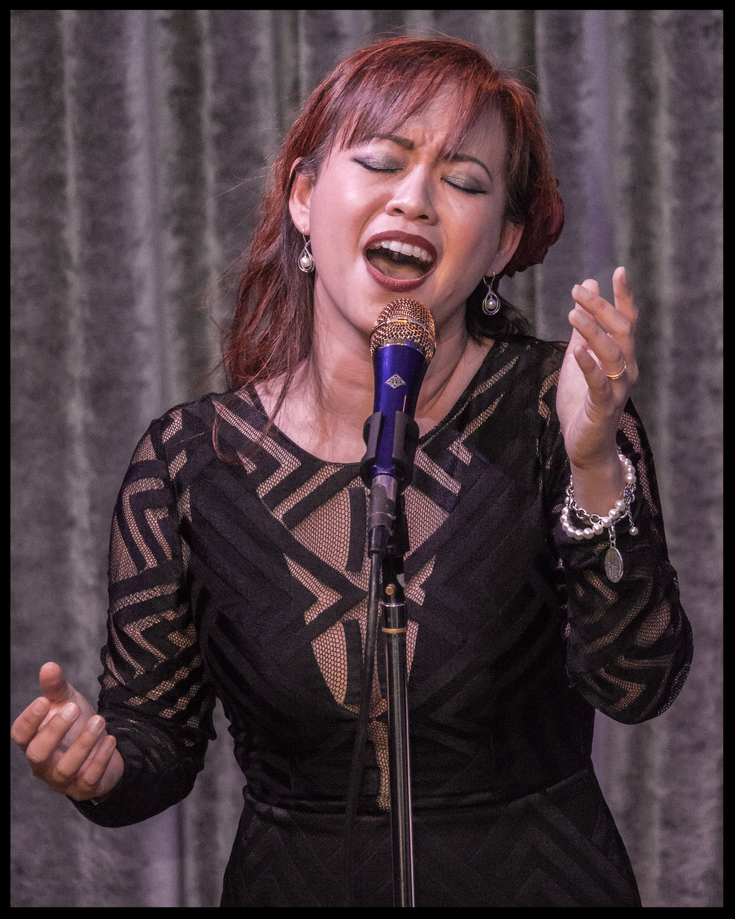 Singing with hands portrait.jpg